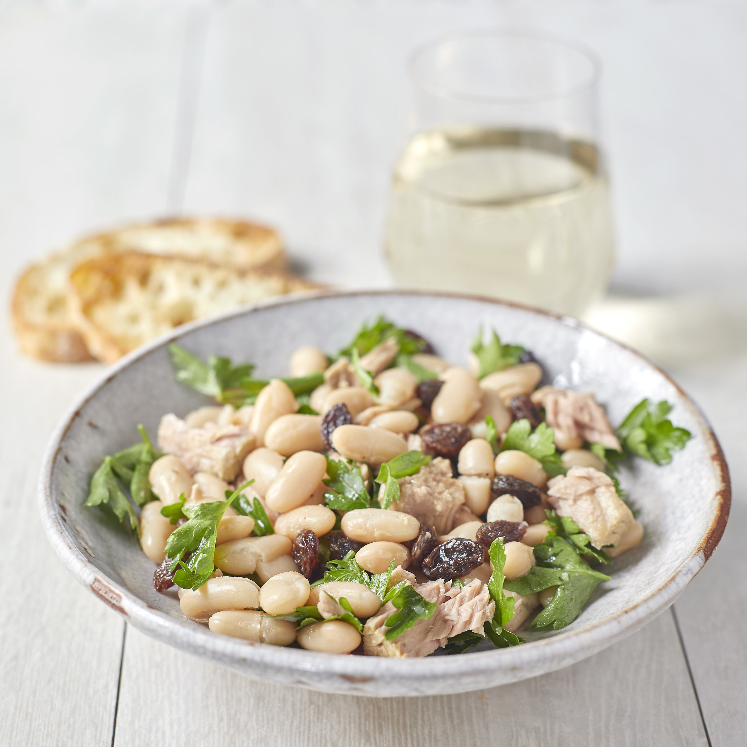 Tuna & White Beans - Ingredients:- 1 Jar of Cole's Wild Caught Premium Tuna Fillets in Olive Oil with Fennel- 2/3 Cup Canned Cannellini Beans, rinsed & drained- 1/4 Cup Raisins- 1/4 Cup Torn Fresh Flat-leaf Parsley- Zest of 1/2 Lemon- 1 Tbsp Fresh Lemon Juice- 1/8 Tsp Course Salt Ground PepperDirections:Mix together the tuna, beans, raisins, parsley, lemon zest, lemon juice, and salt. Season with pepper.