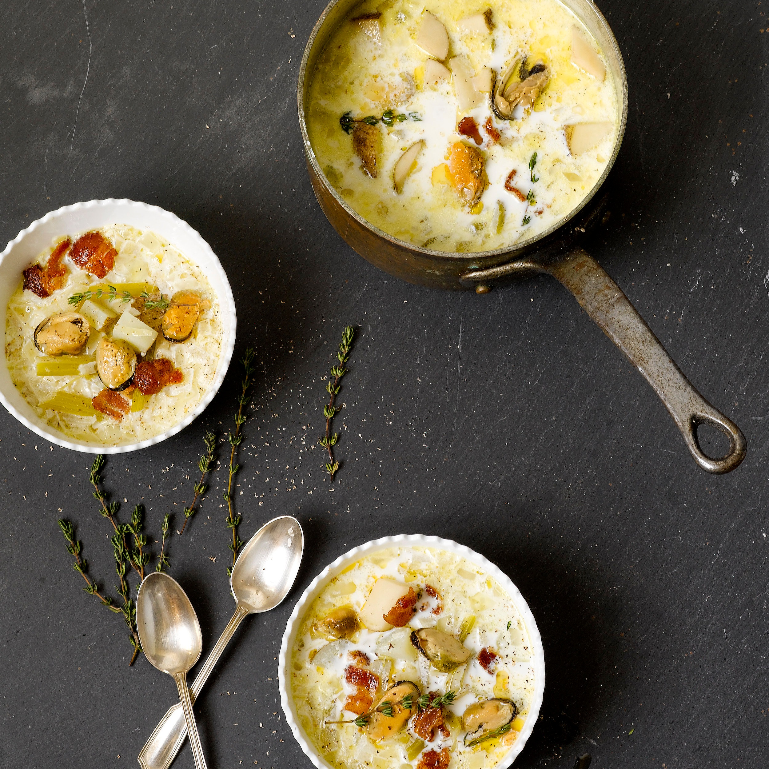 "Smoked Mussels Bisque with Fennel & Potatoes - Ingredients:- 2 Strips Bacon- 1 Tbsp Butter- 1 Medium Onion, finely diced- 4 Celery Stalks, thinly sliced- 1 Large Fennel Bulb, stalks discarded and bulb finely diced- 2 Sprigs Fresh Thyme- 4 Large Russet Potatoes, peels left on, cut into 1-inch pieces- 2 Tins of Cole's Smoked Mussels- 4 Cups Water- 2 Cups Half and Half- Freshly Grated NutmegDirections:Heat the bacon and butter together over medium heat in a large saucepan. When most of the bacon has been rendered and the meat begins to turn dark brown, add the onion, celery, fennel bulb, and thyme. Cook until the vegetables are translucent, stirring occasionally, about 5 minutes. Add the potatoes, mussels, and water. Bring to a simmer and cook until the potatoes begin to fall apart, about 20 minutes.Add the half-and-half and turn the heat off. Stir to combine and let sit for 20 minutes so all the flavors can meld.Divide the bisque among 4 soup bowls and garnish with a few gratings of nutmeg.Serves 4.*(recipe adapted from ""For Cod and Country: Simple, Delicious, Sustainable Cooking"" by Barton Seaver)*"