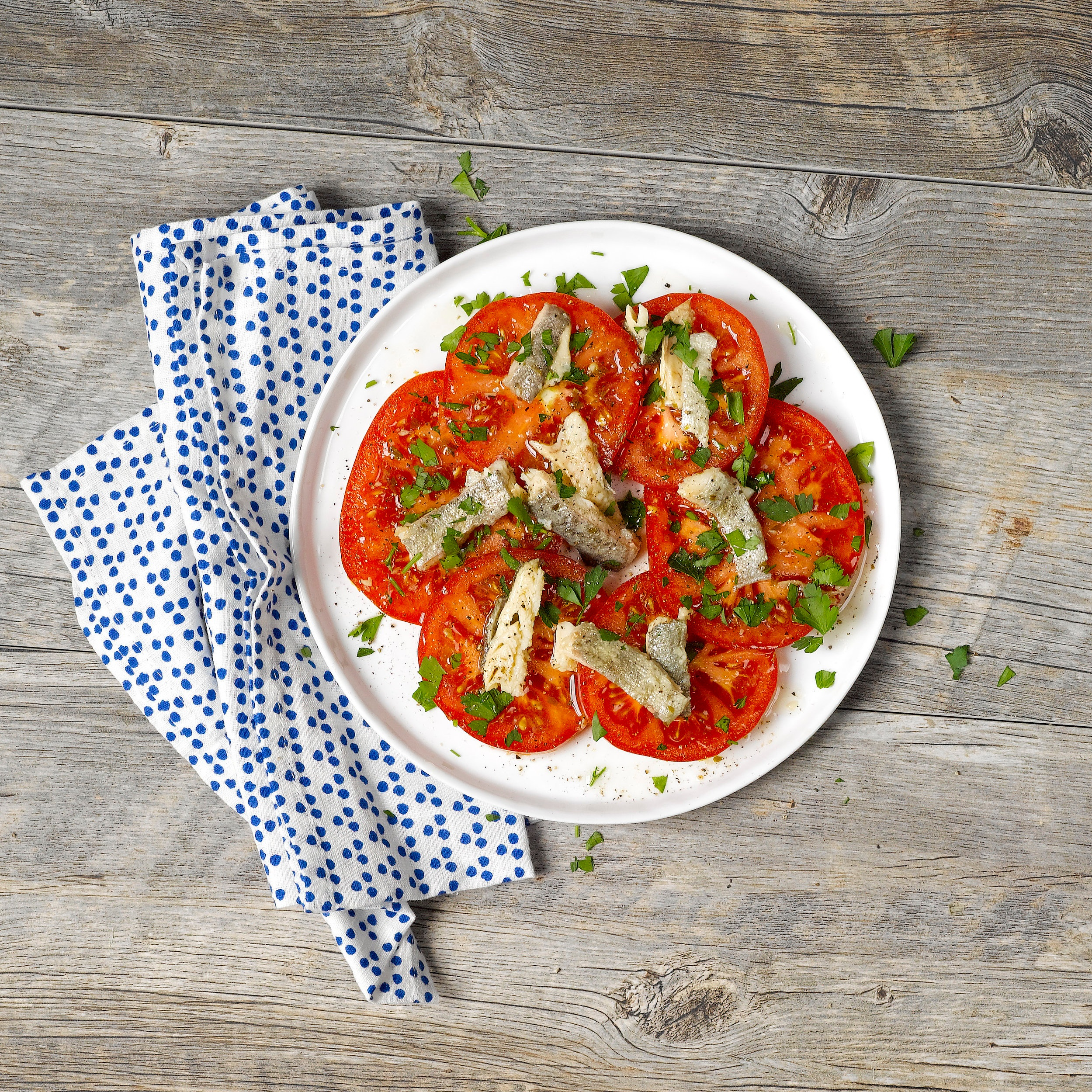 Tomatoes & Herbs Topped with Smoked Trout - Our Smoked Trout makes a perfect complement to some freshly sliced tomatoes. Top off your plate with some parsley, salt/pepper, and you have a deliciously healthy, light summer lunch!