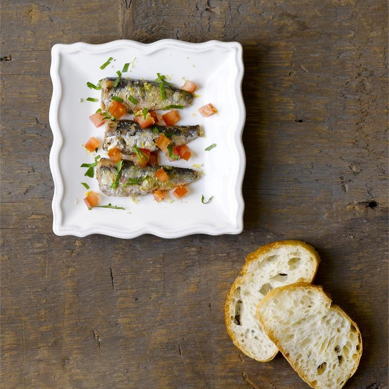 Smoked Sardines with Tomatoes & Parsley - Instructions:Take one can of Cole's Smoked Sardines in Olive Oil, arrange on plate, and top with a diced tomato, chopped flat leaf parsley, and the zest from a lemon.