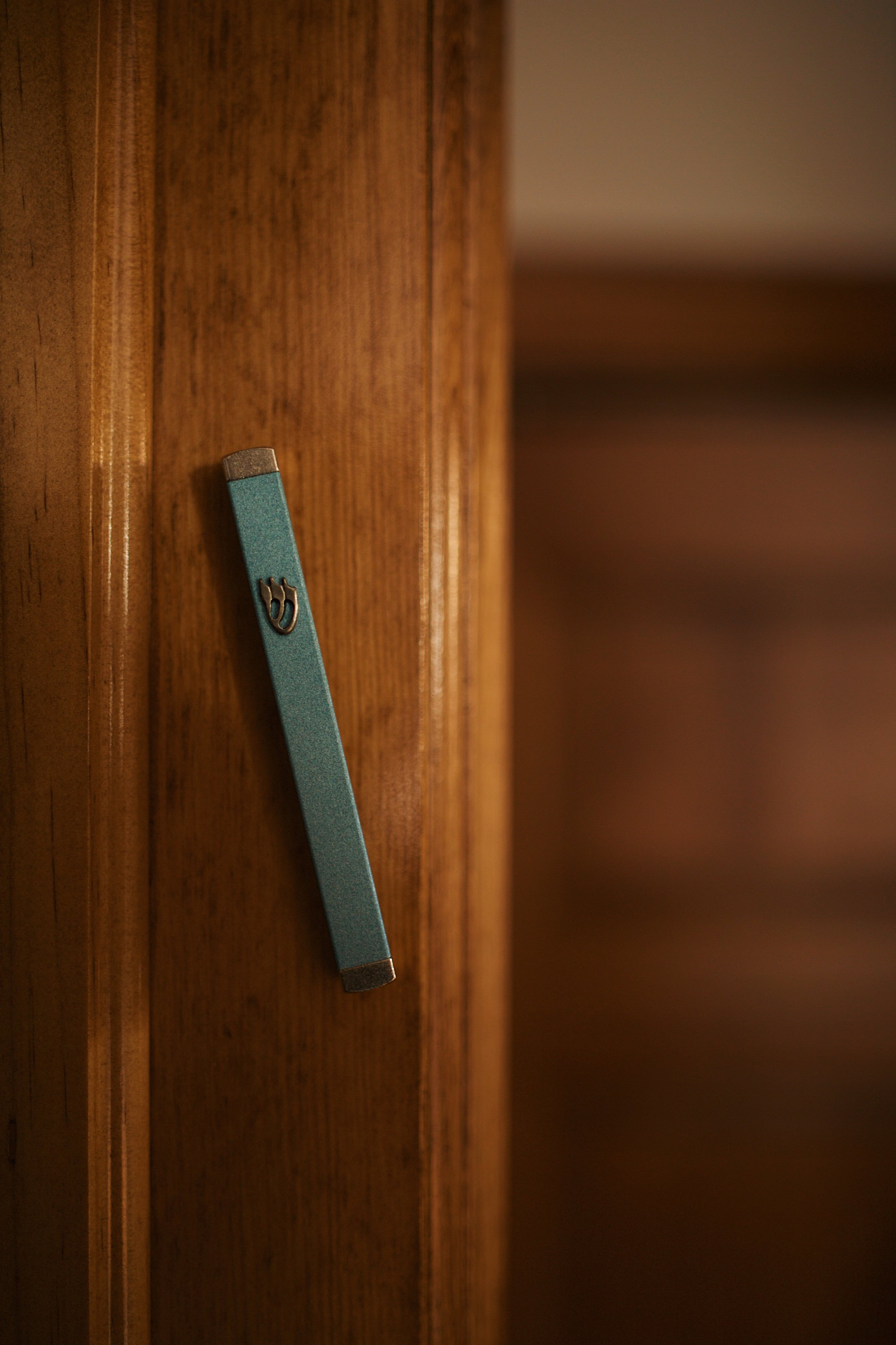 The mezuzah on the doorway of Jade's bedroom