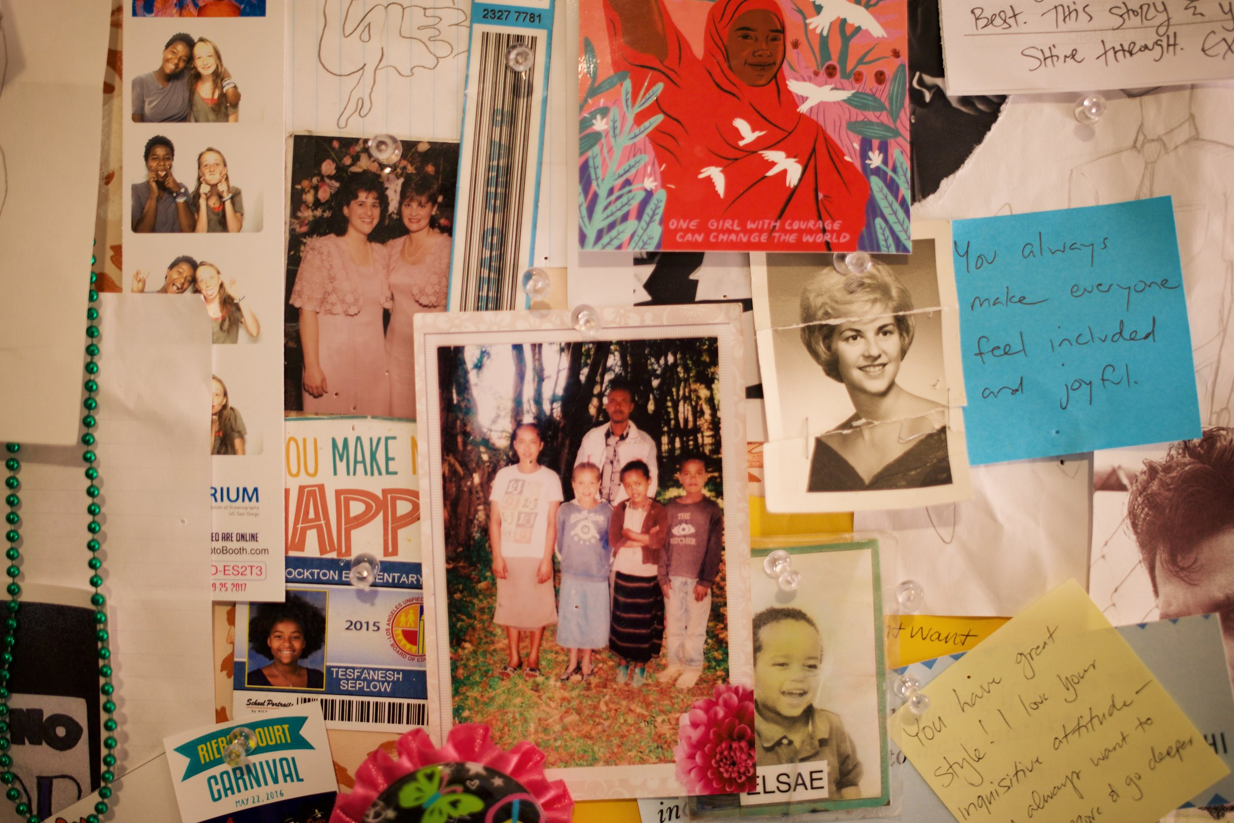 Tesfanesh's bulletin board in her room. The photo in the middle is of her four other siblings in Ethiopia.