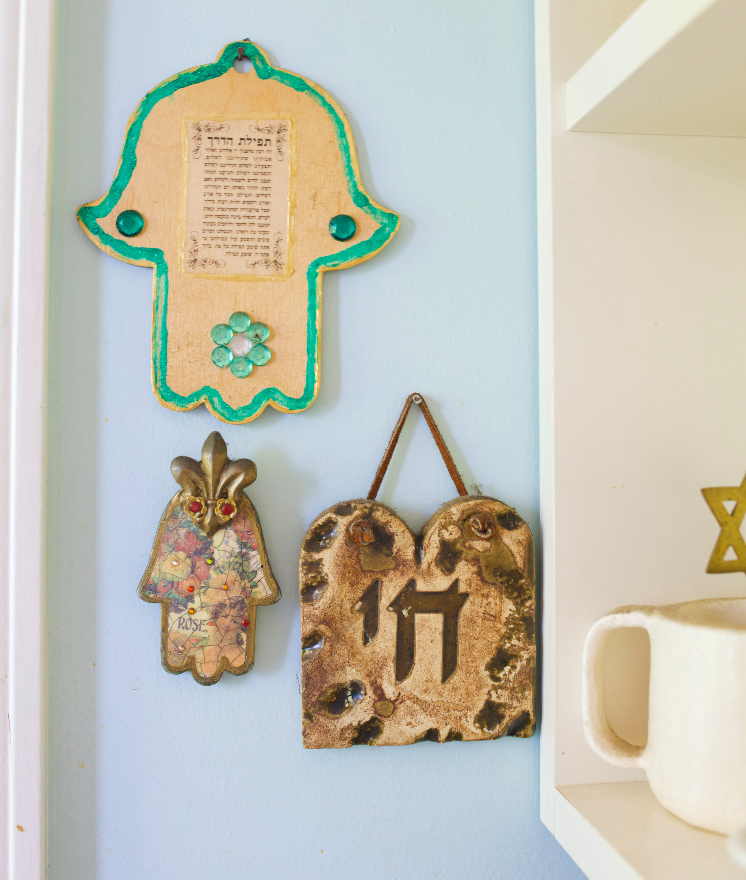 A hamsa Marlee made when she was 11 that hangs in her kitchen