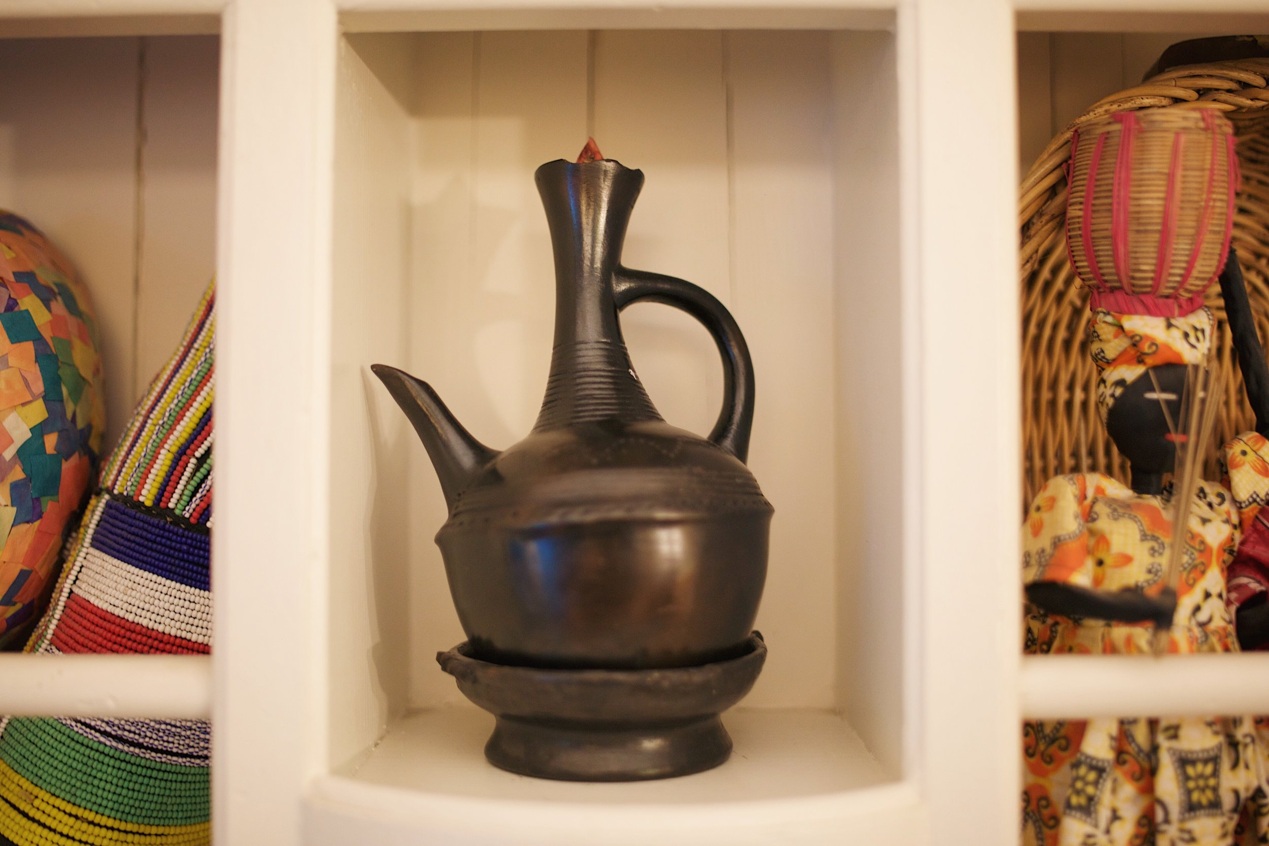 A coffee pot Ethiopians drink out of either at every meal, or by itself. Tesfanesh loves the smell of coffee. Where she is from in Ethiopia is known for being the largest producer of coffee in Ethiopia.