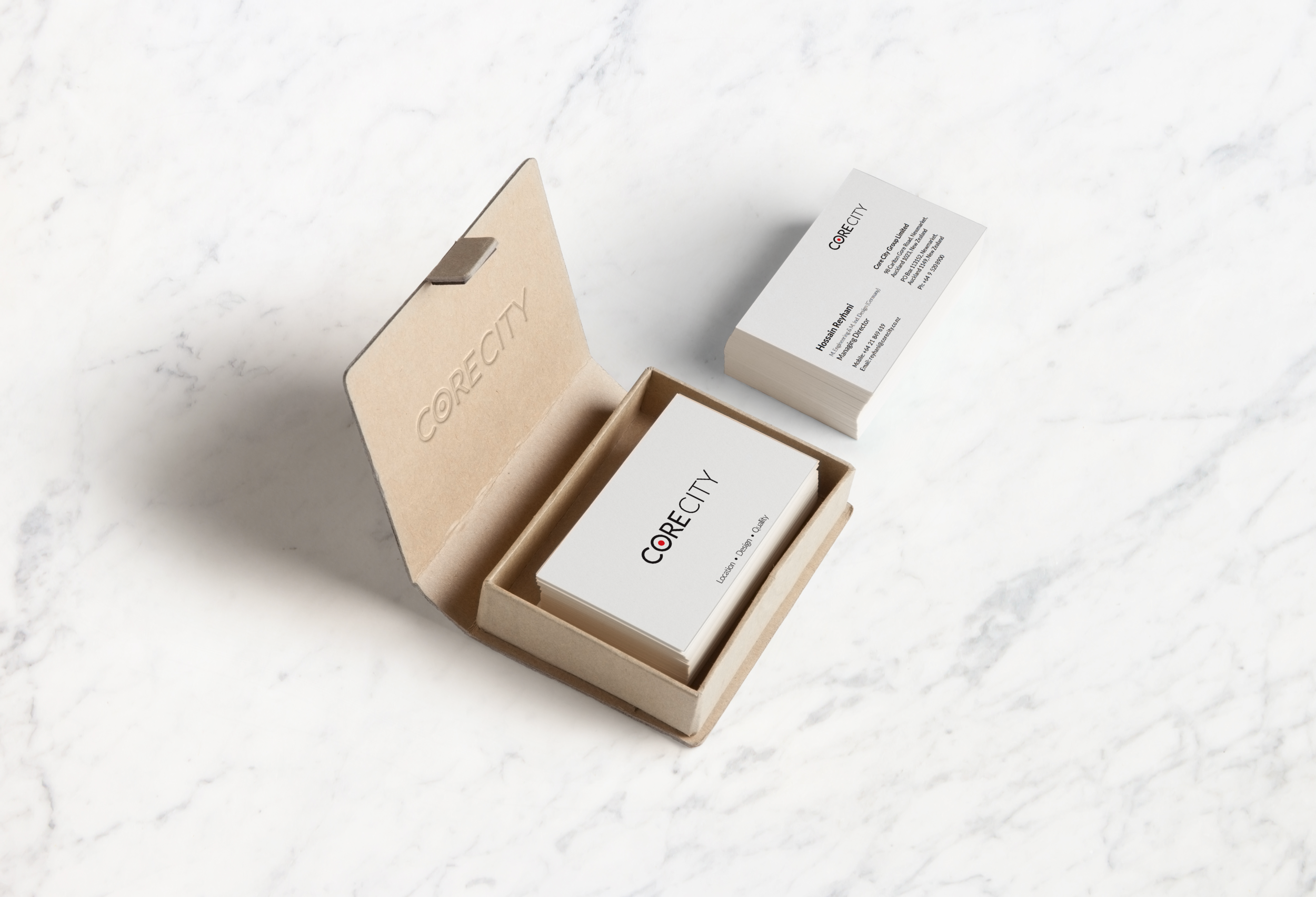 Business cards displayed in a card holder box
