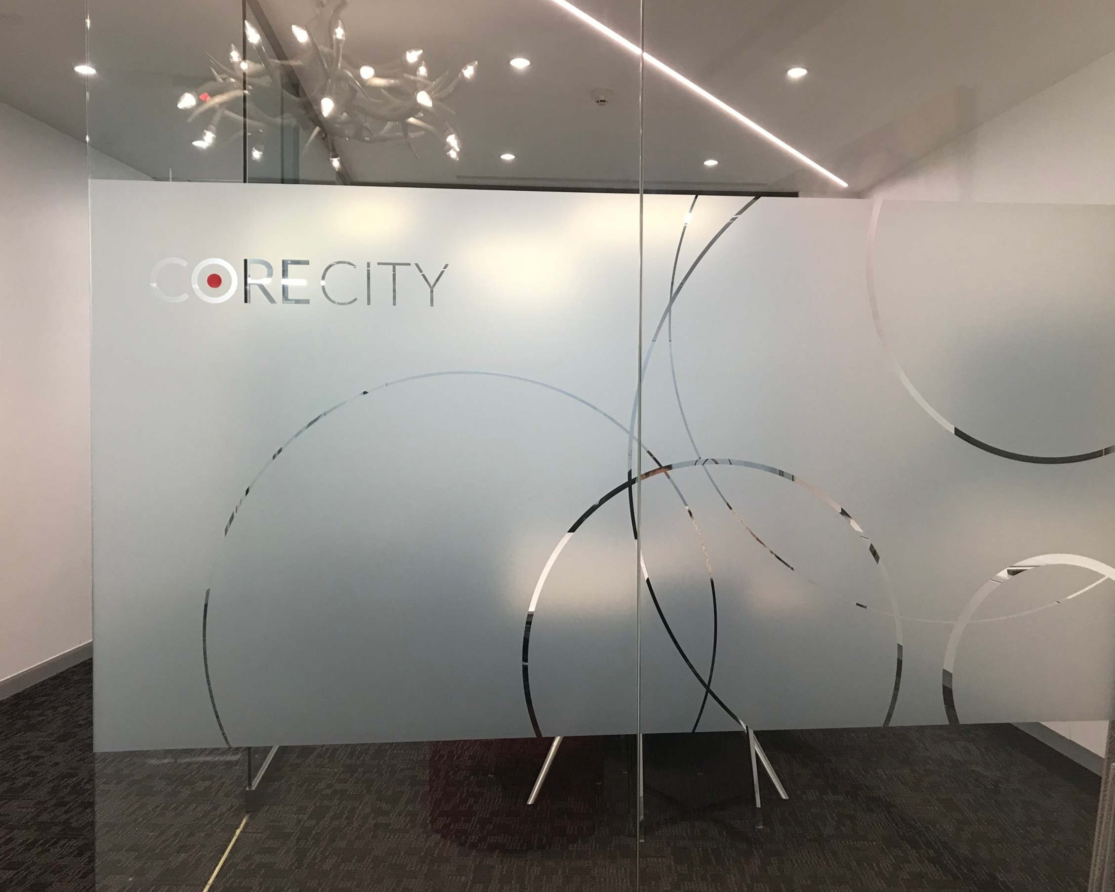 Logo and brand pattern signage on frosted glass