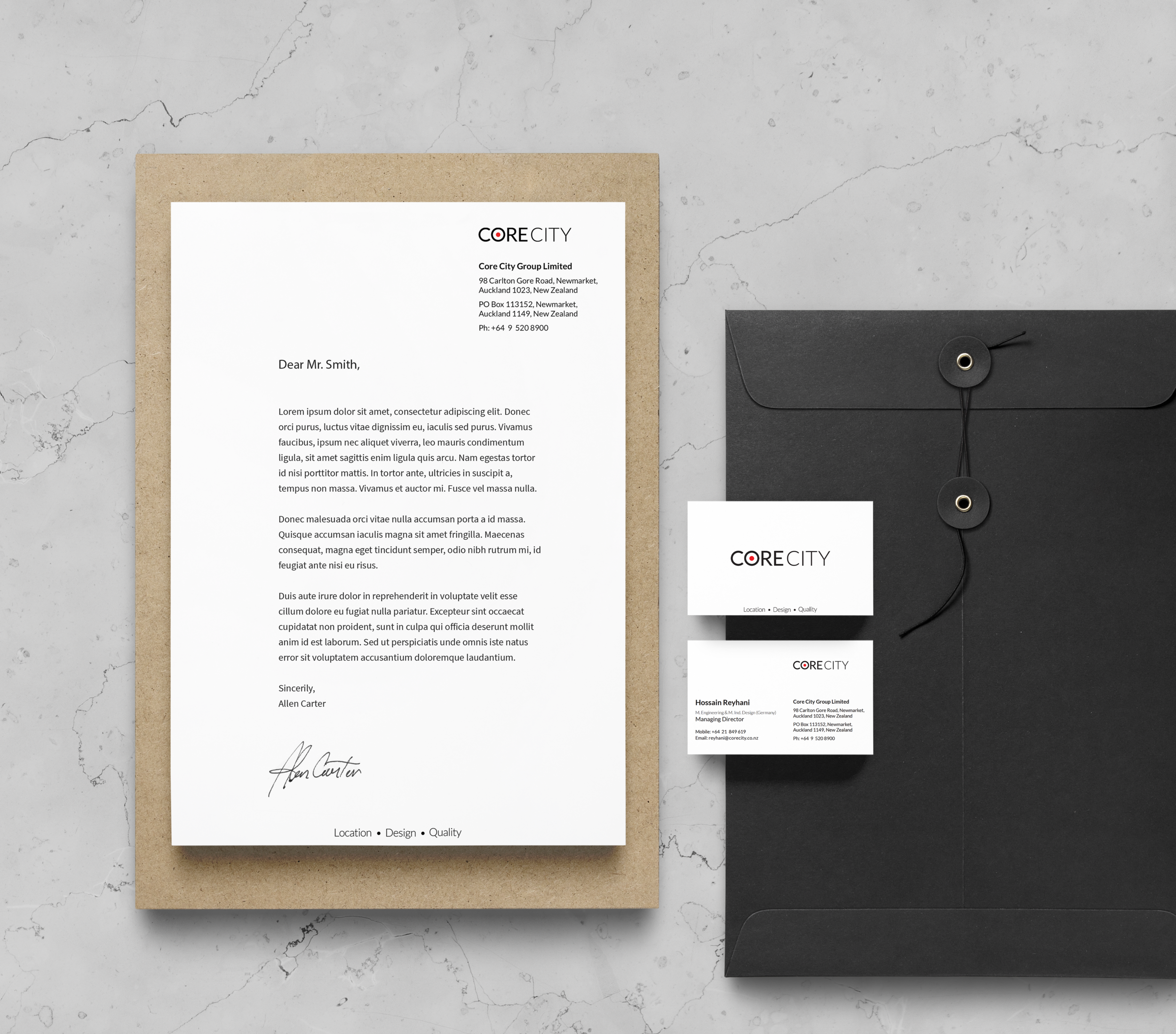 Neatly arranged brand letter, envelope, and business cards