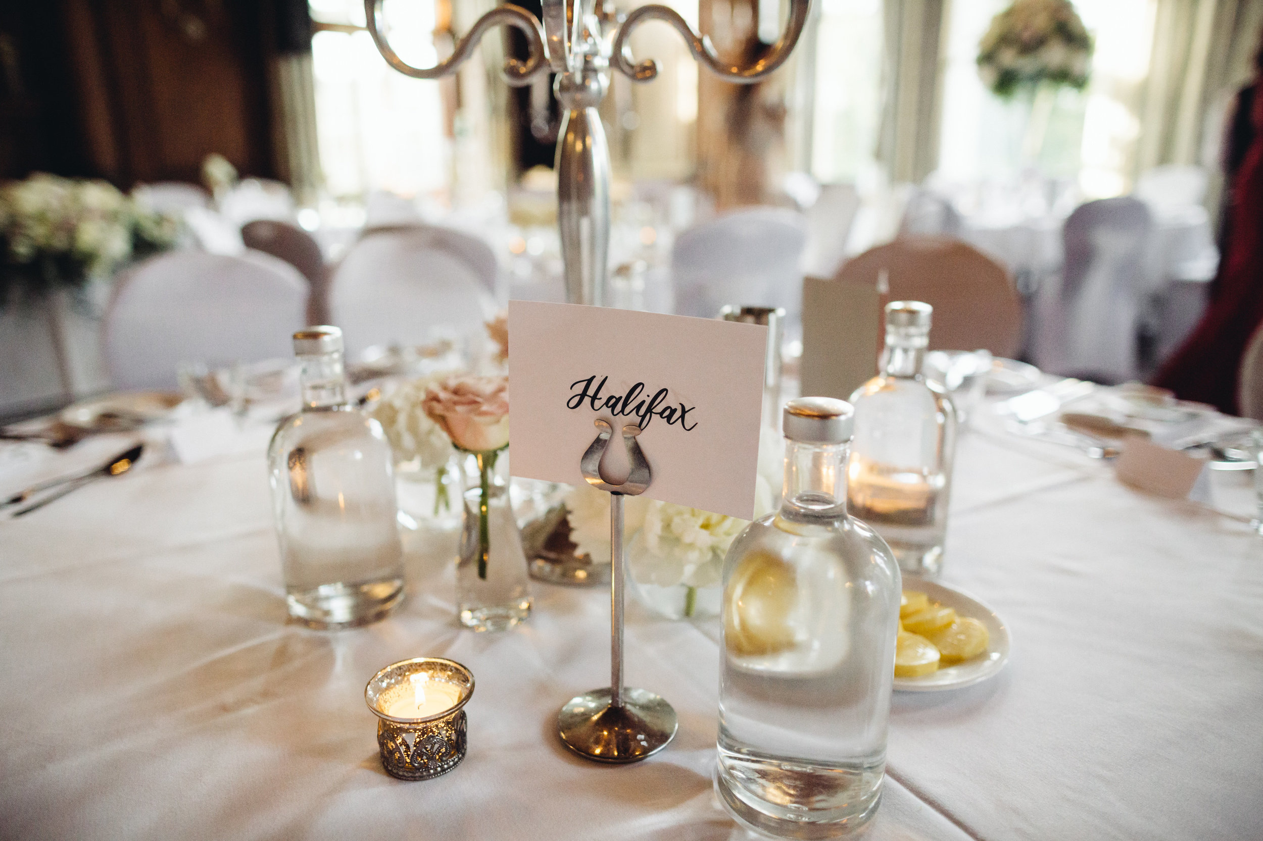 A wedding table with a table name sign