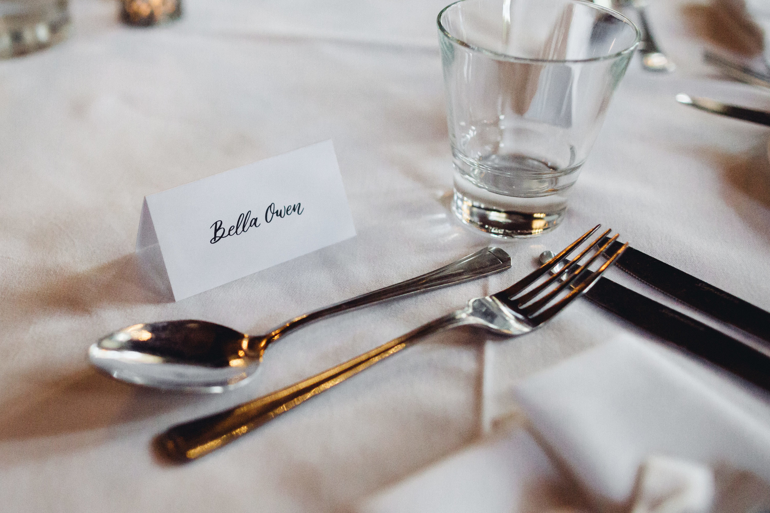 Close up of a wedding table with a place card