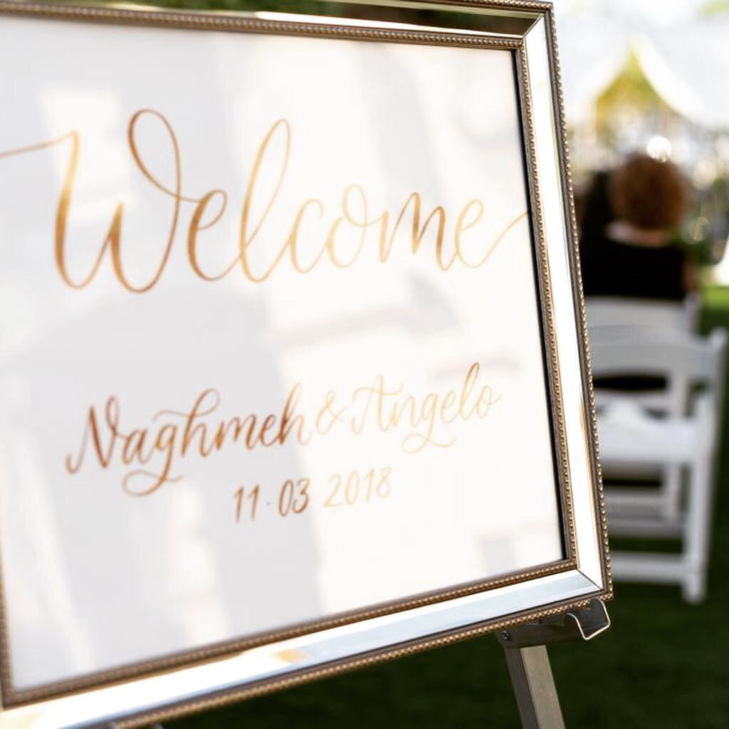 A close of a framed wedding welcome sign