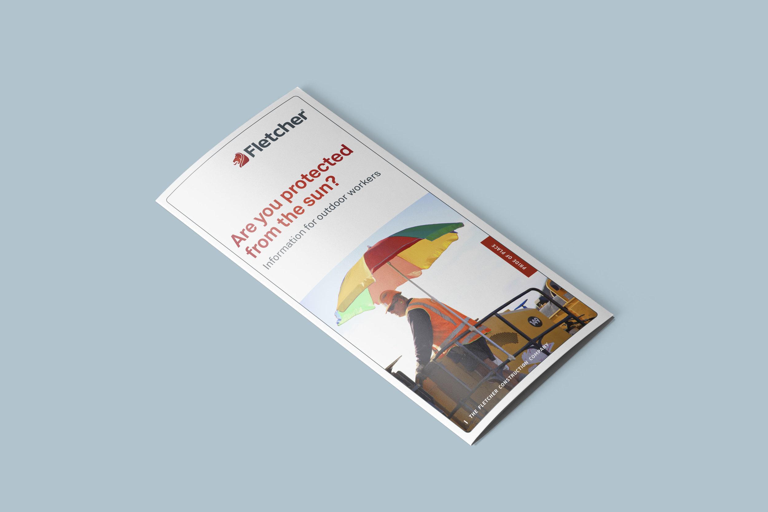 A closed tri-fold leaflet on a table