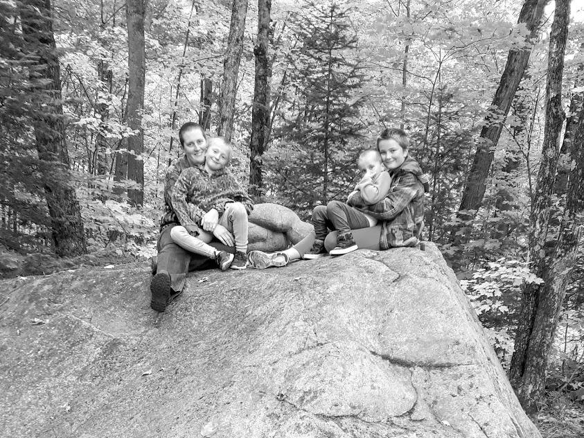 Adrienne M. Clark with her three daughters in the Haliburton Sculpture forest behind Haliburton Campus of Art + Design, 2018