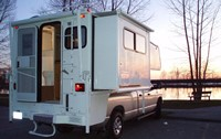Supreme Truck-Camper 22/23 ft (6,5m) - Super design – Slide-outFor 2 to 4 people; very comfortable. Large driver's cabin! Camper top has slide-out, making the inside space slightly larger. Tall shower, and 150 l water tank. No access to truck cab.