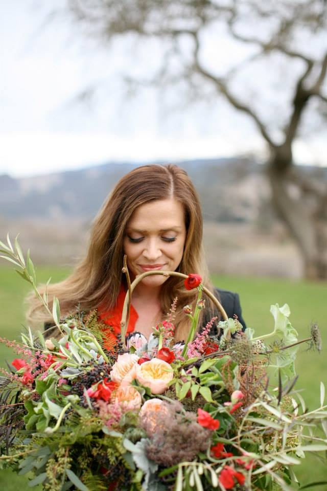 Hello! My name is Sara Balmer, and I am the Barefoot Florista.  I've been playing with flowers ever since I was a very small child in my grandma's gardens! My interest in flowers developed from a young age, and was nurtured by my grandmothers and my father. I spent many of my summer days as a kid wandering up and down the aisles of a neighborhood greenhouse. There was something intriguing, and even magical I found about flowers and nature that drew me in. To this day I never tire of seeing a poppy bloom, or a lilac burst open. Every year I'm in awe. I stumbled into a floristry career in 2005, and fourteen years later, I still enjoy creating luxurious floral designs for all types of events. Flowers can set the tone for your wedding, event, or party. I specialize in creating elegant, lush, unforgettable, wedding, event and celebration of life florals for my clients.  I love getting to know each client. I take pleasure in making my client's floral visions come to life!  I look forward to meeting you soon!