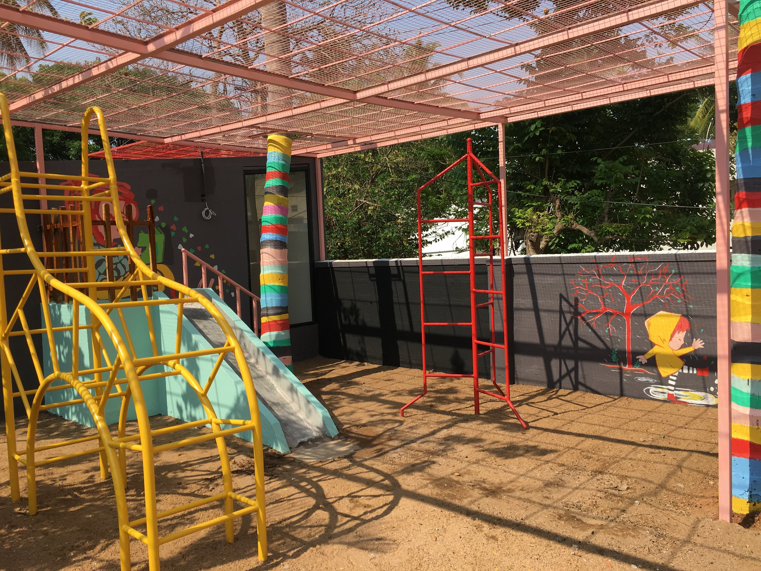 The Outdoor Environment - o Designed into 3 zones that provides opportunities for gross and fine motor play.o Playhouse - for the children to indulge in free form play and learningo Amphitheater - multi functional space for exercise and outdoor activity lessonso Play area - outdoor play gym equipment