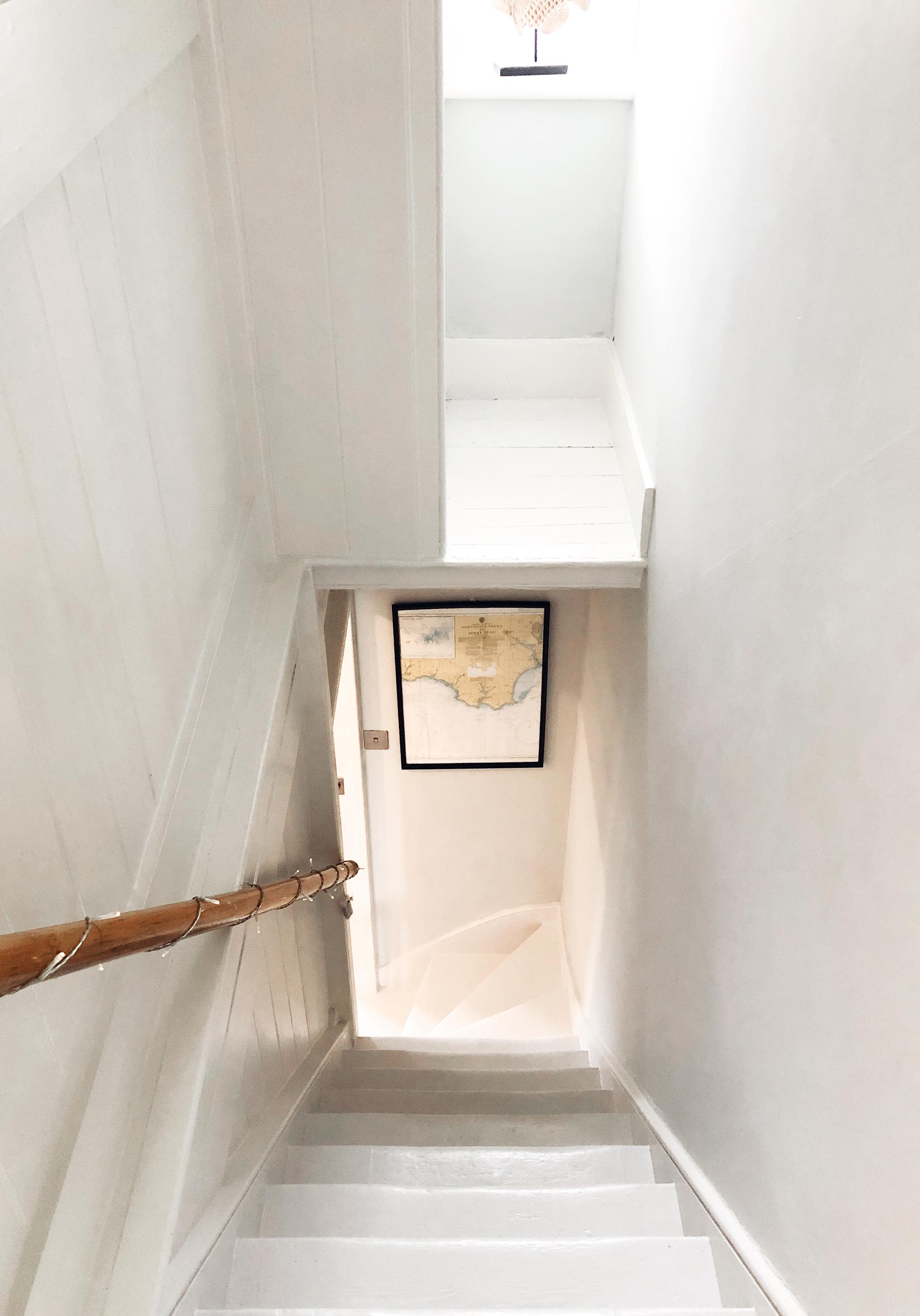 2 white wooden cottage staircase.jpg