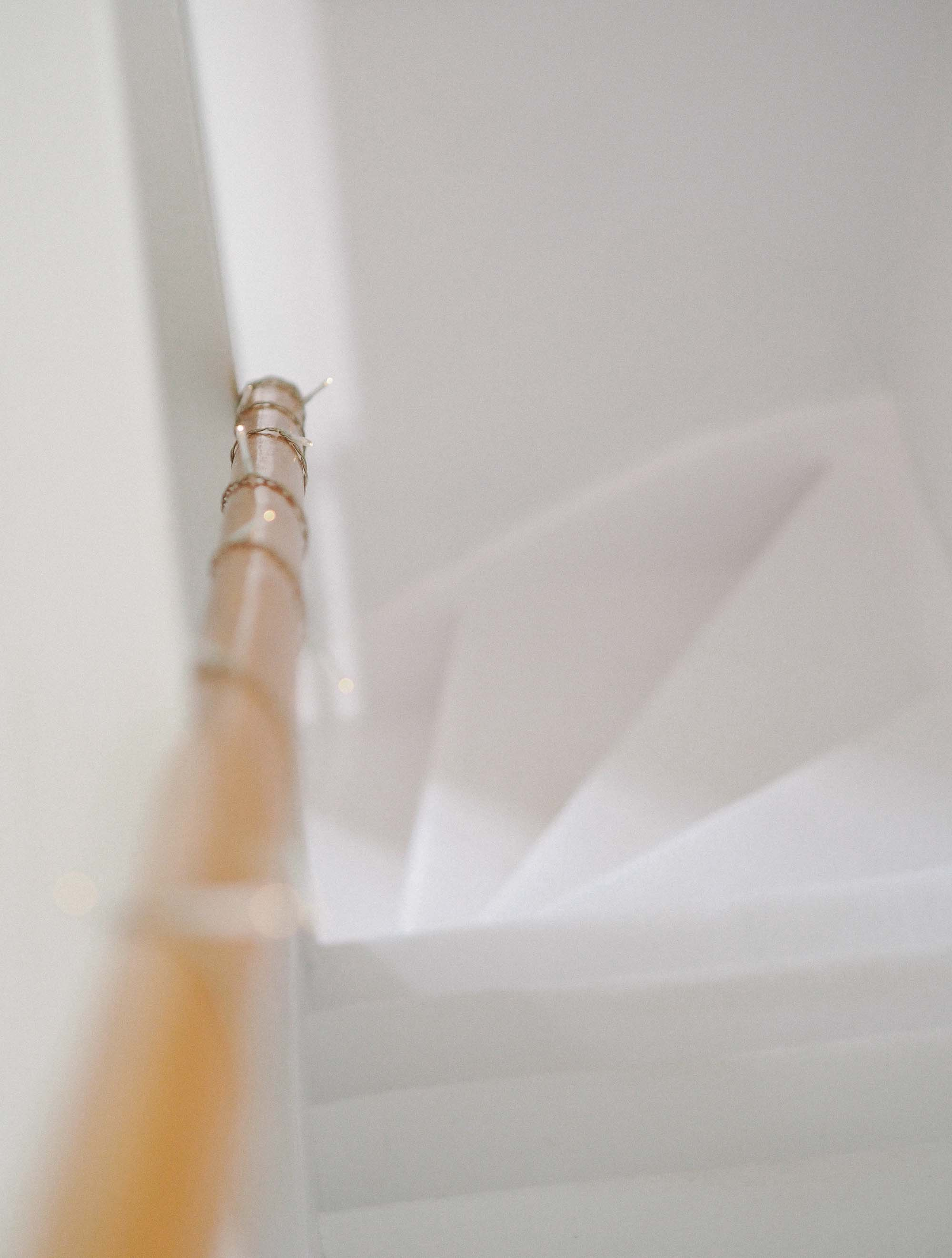 3 twinkle lights on white wooden staircase.jpg