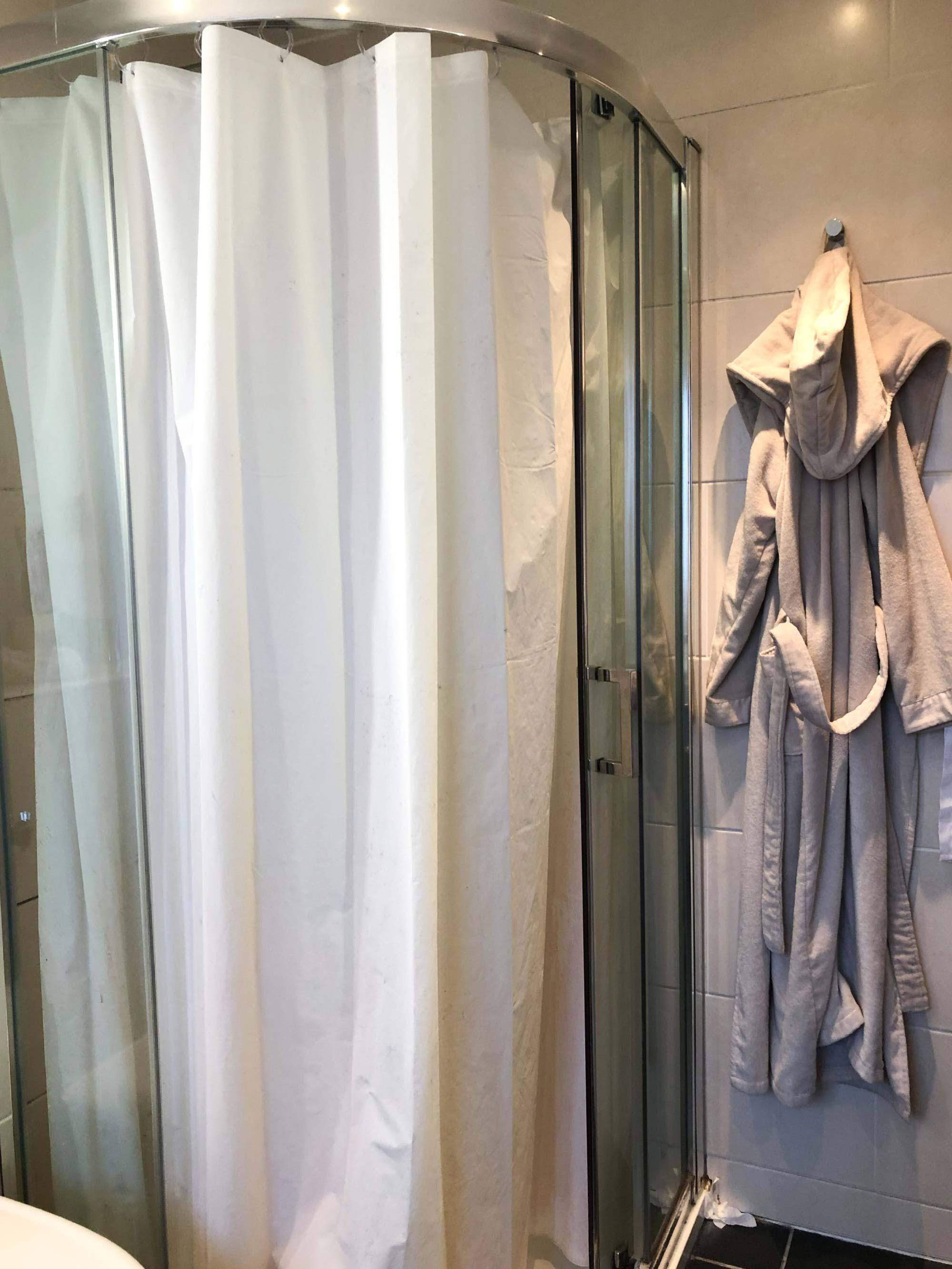 4 shower-curtain-hung-in-place-of-broken-door.jpg