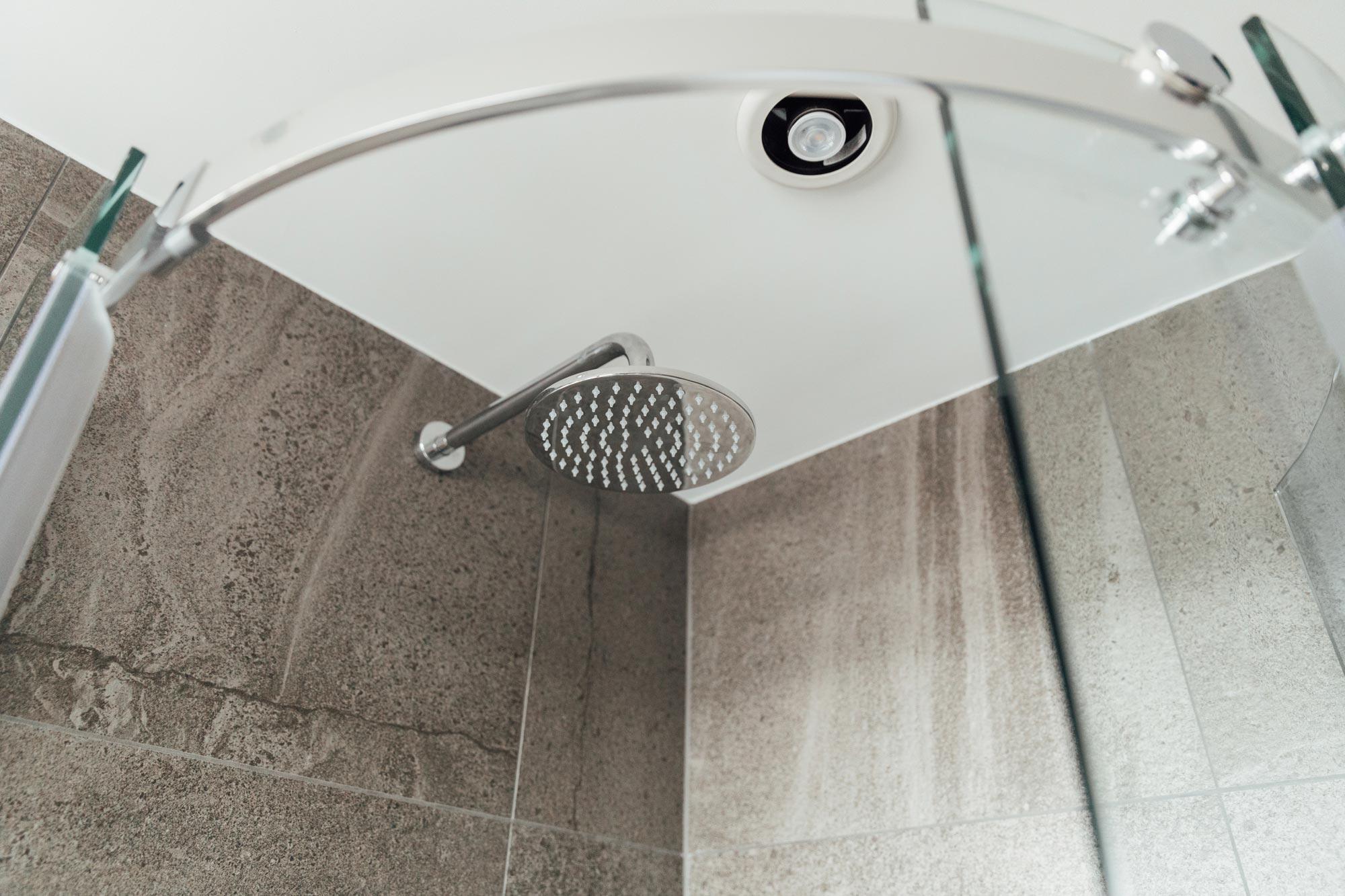 4 large-rainfall-shower-head-in-chrome-drak-tiles.jpg