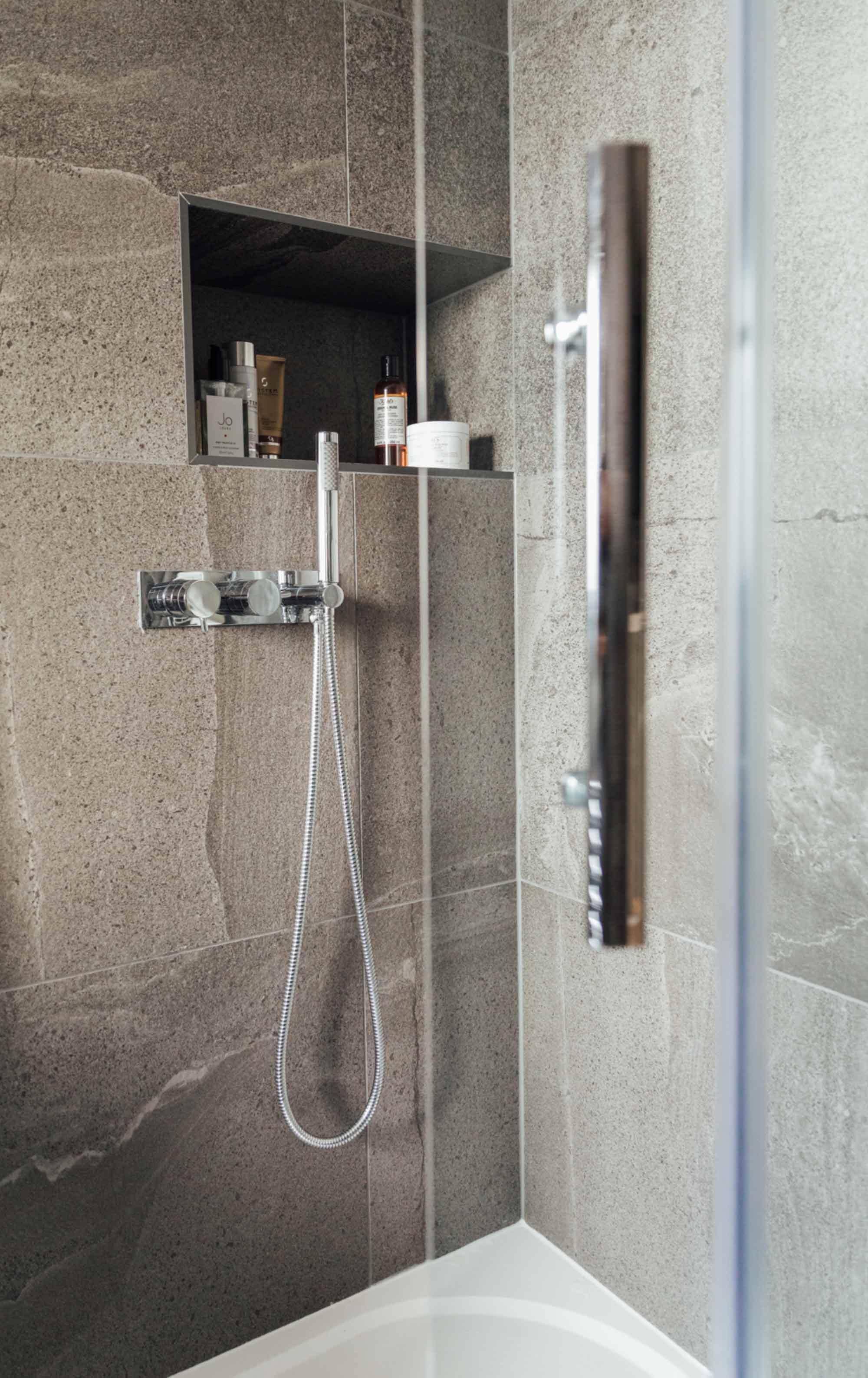 4a dark-grey-tiled-shower-with-recess-shelf-for-storage.jpg