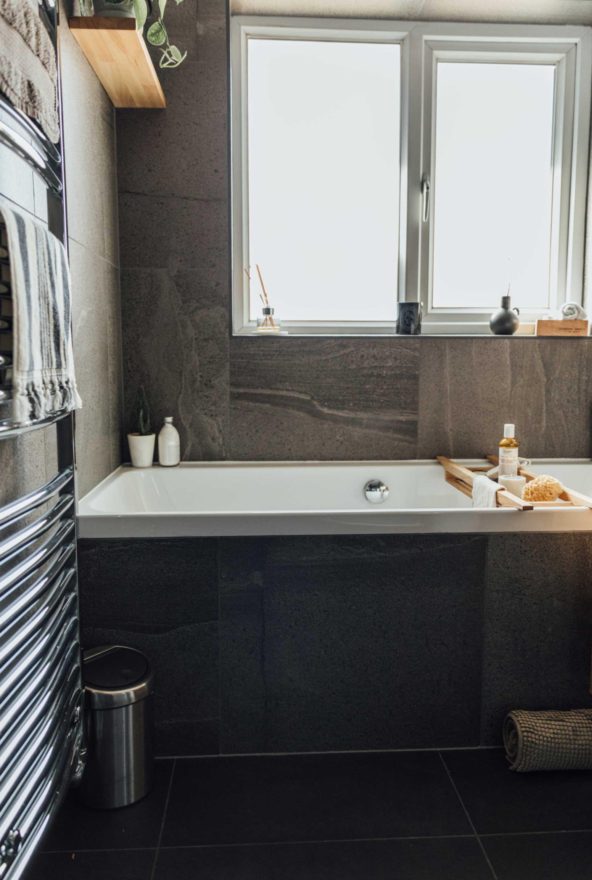10 dark-tiled-bathroom-with-white-sanitaryware.jpg
