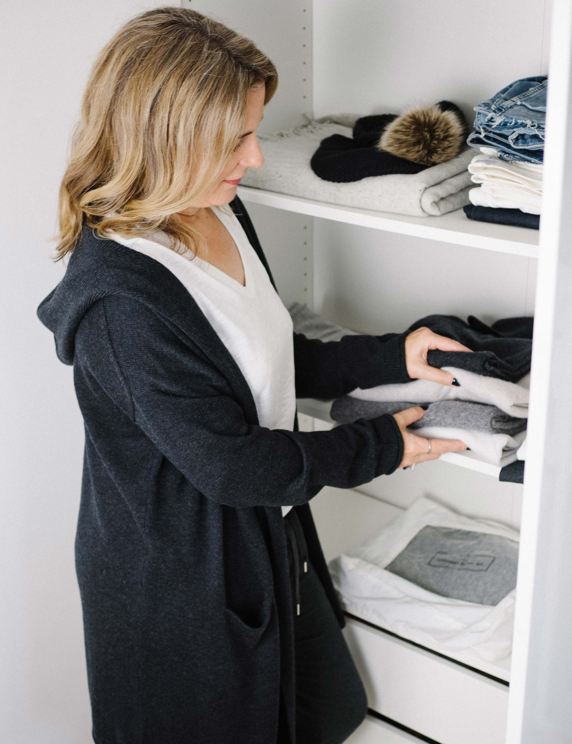 9 putting-away-sweaters-and-jeans.jpg
