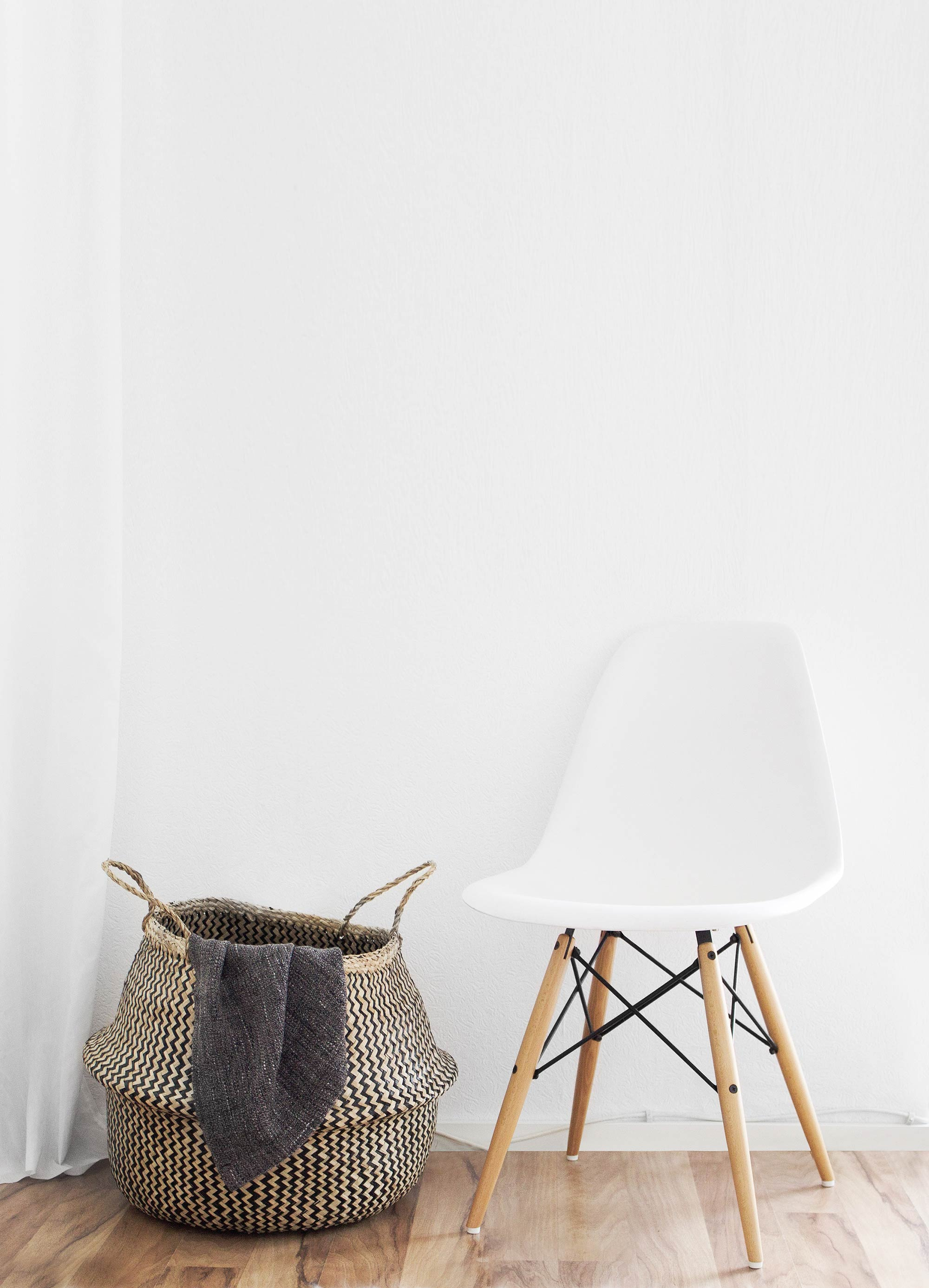 2-white-eames-chair-on-wooden-floor.jpg