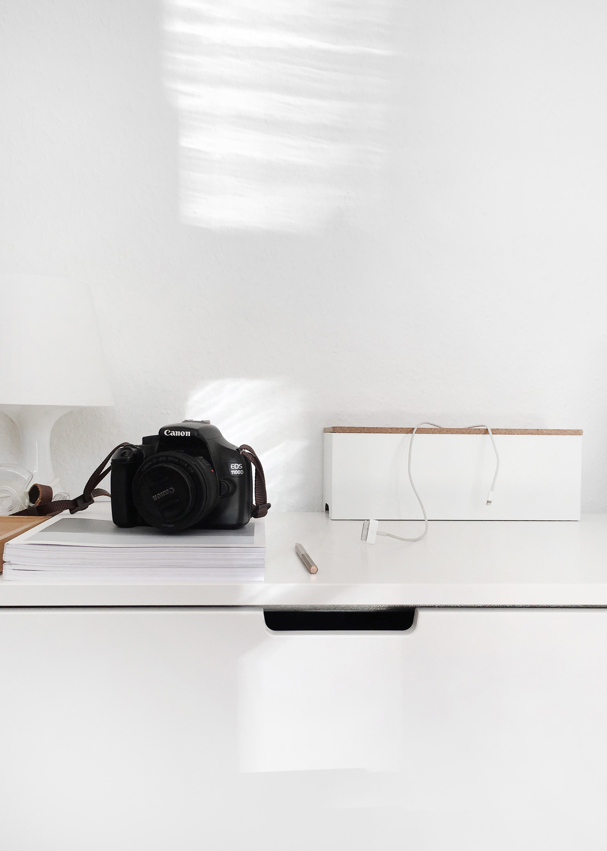 5-camera-on-desk-in-minimal-white-studio.jpg