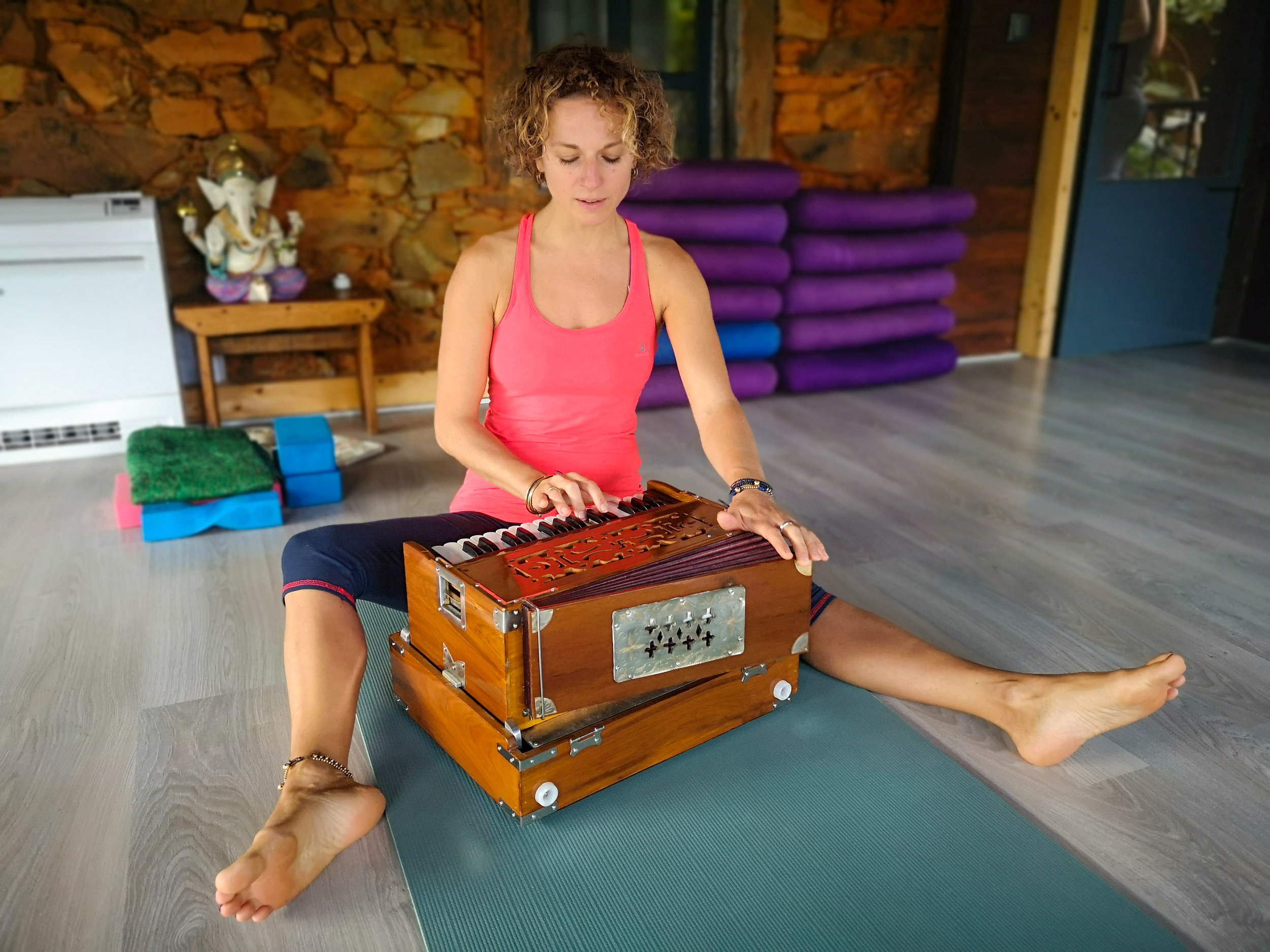 Playing harmonium with a yogic mantra.jpg