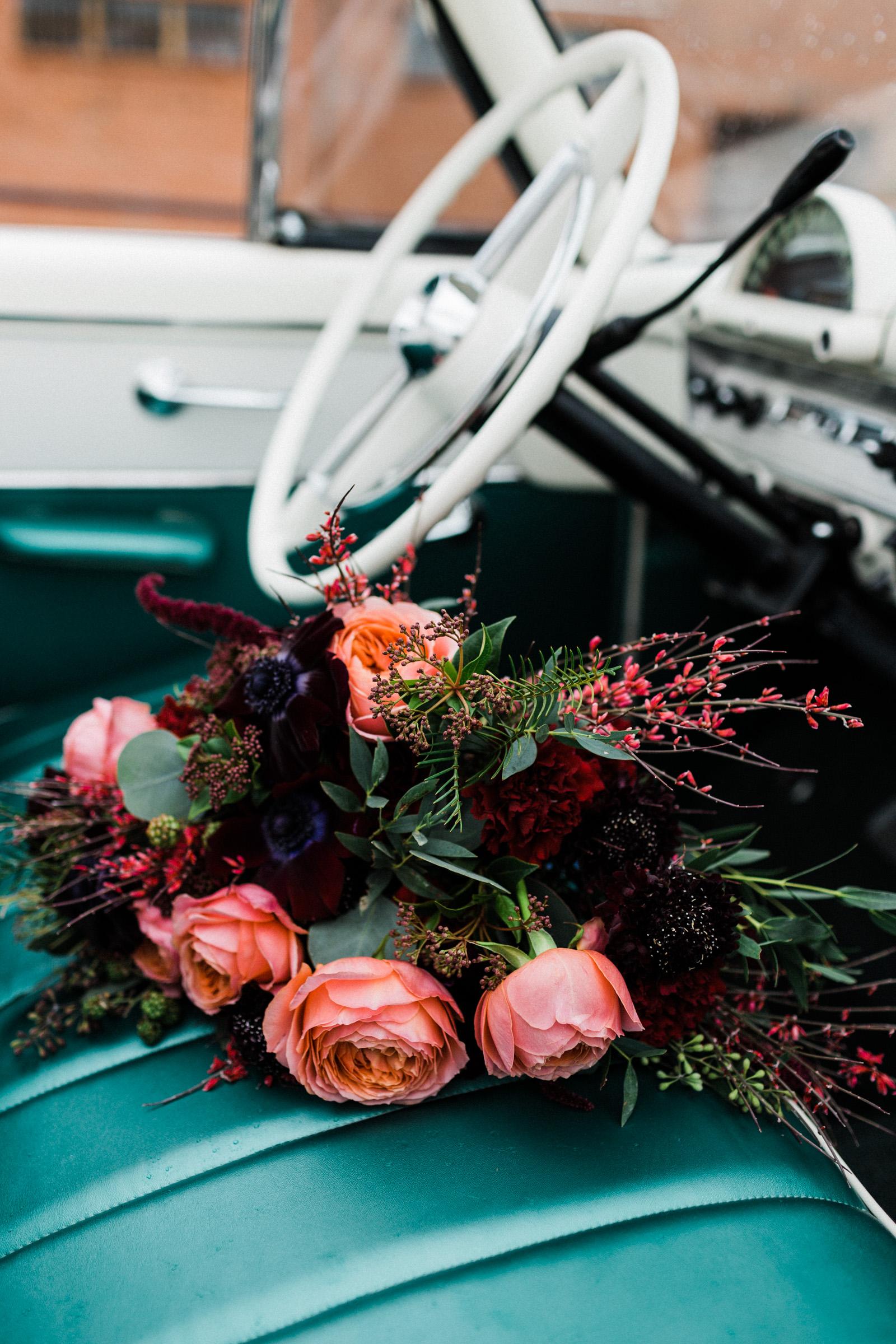 Bridal bouquet in a vintage car