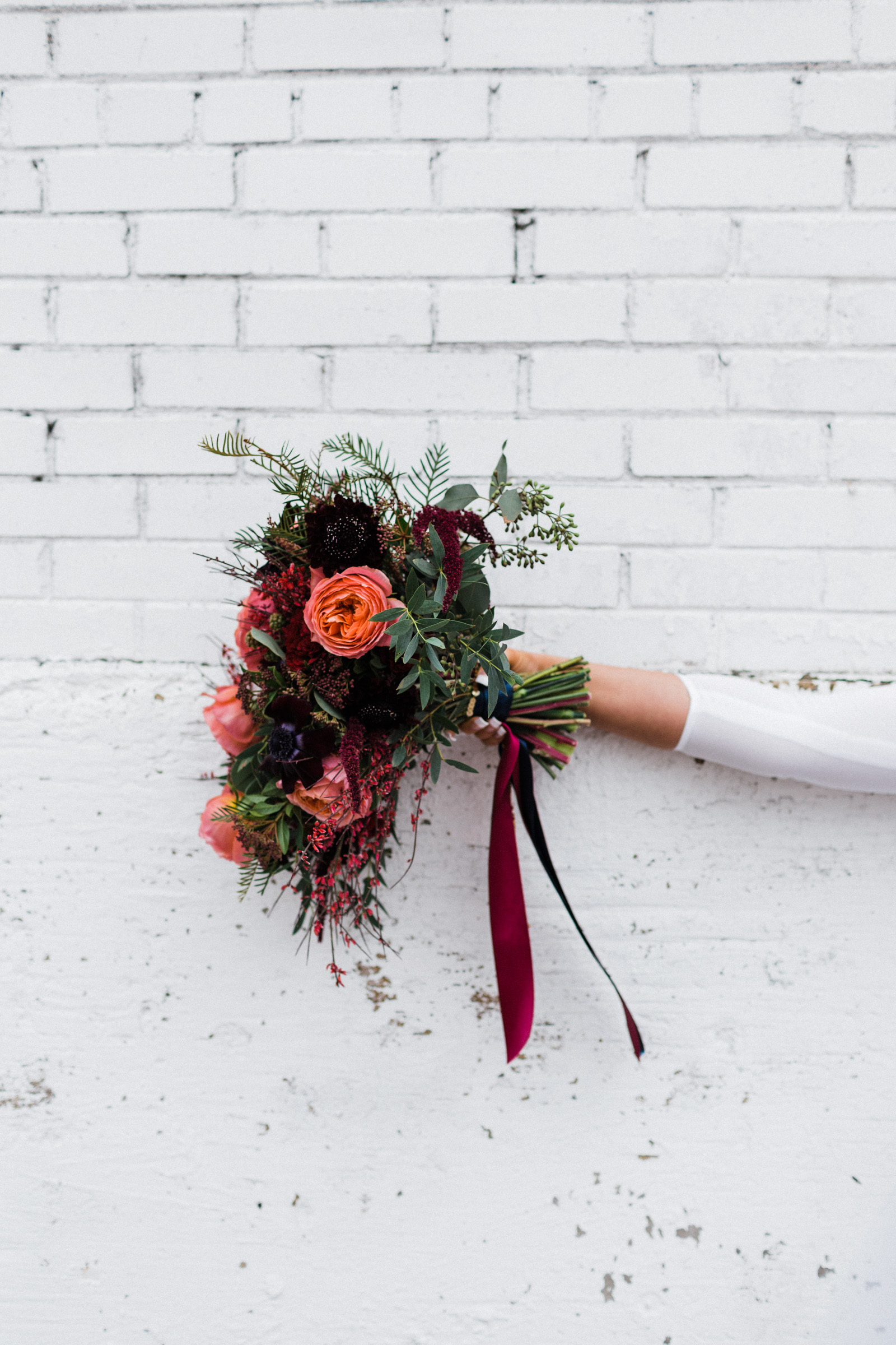 Wedding bouquet on white wall