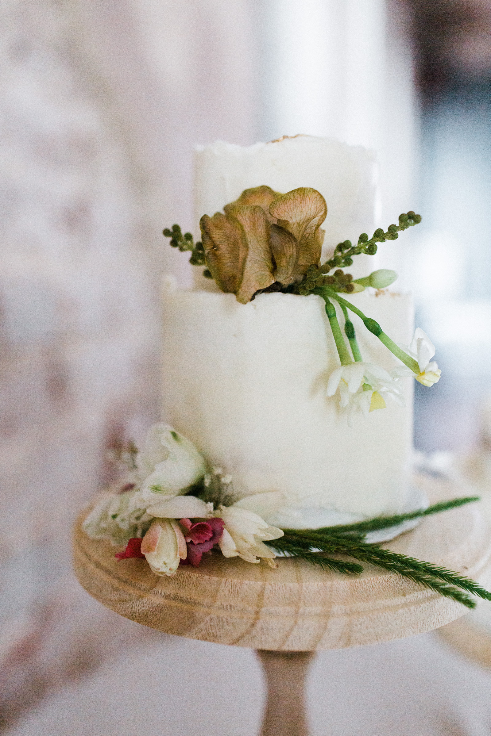 A wedding cake in the century hall reception space in fort worth texas