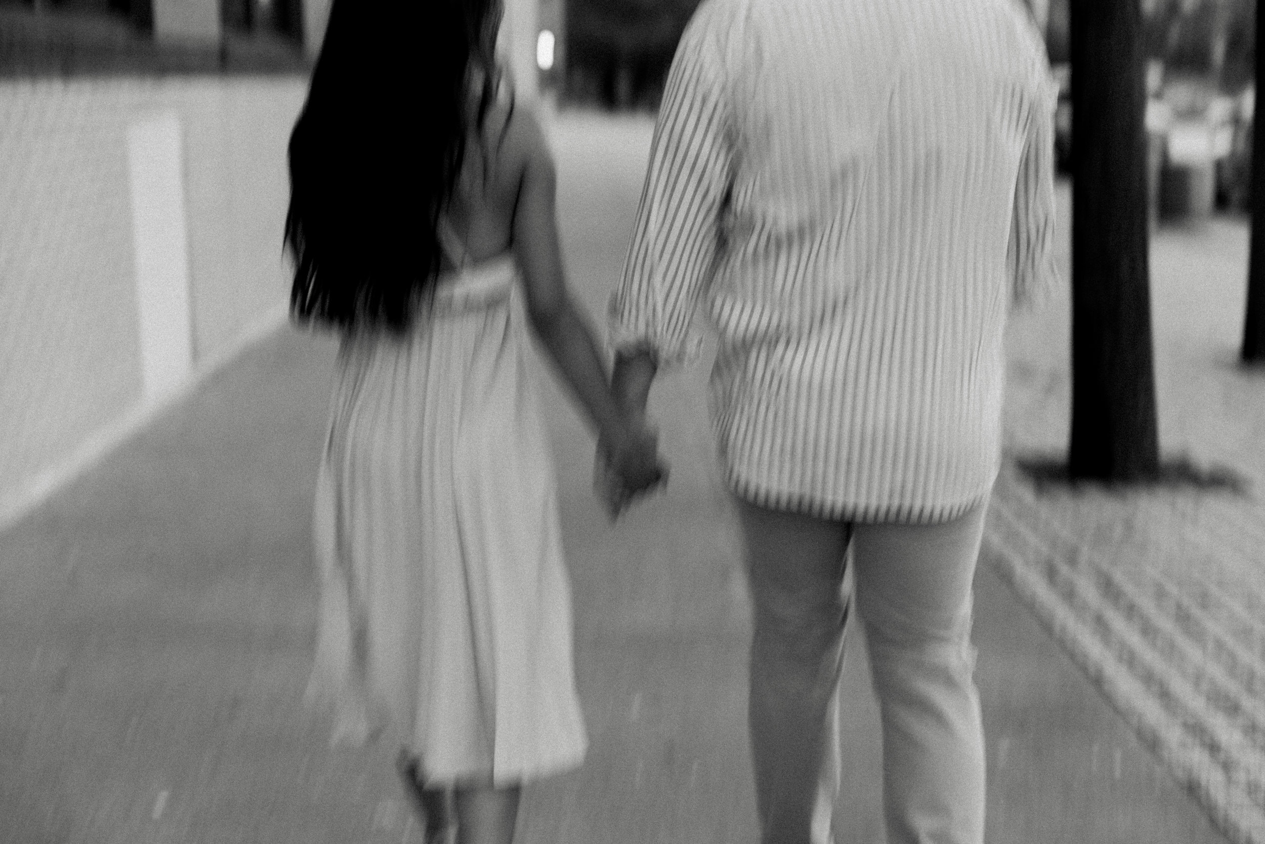 Engagement pictures walking and holding hands
