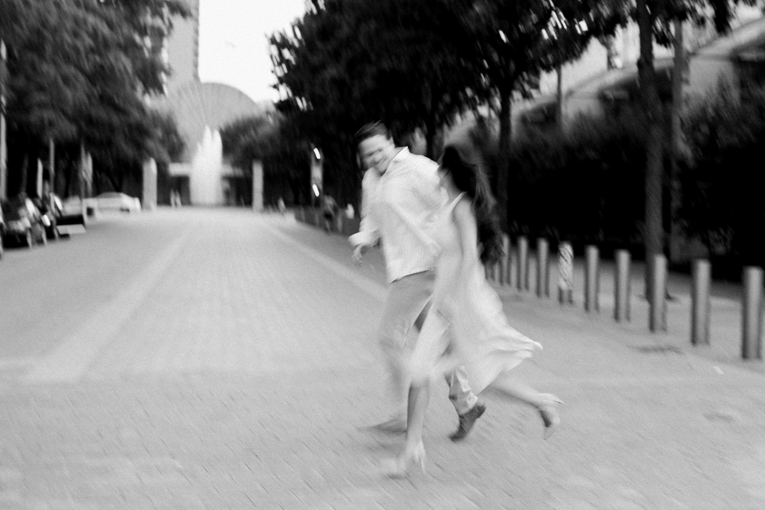 Couple running across street