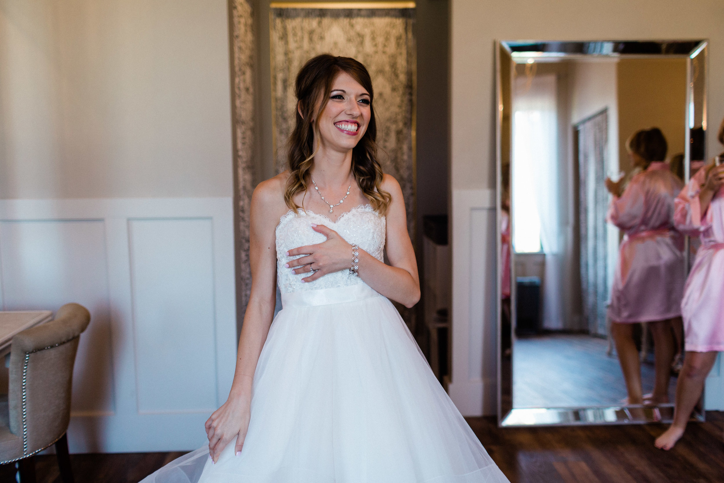 Adelia getting ready in her bridal suite on her wedding day at Chandler's Gardens