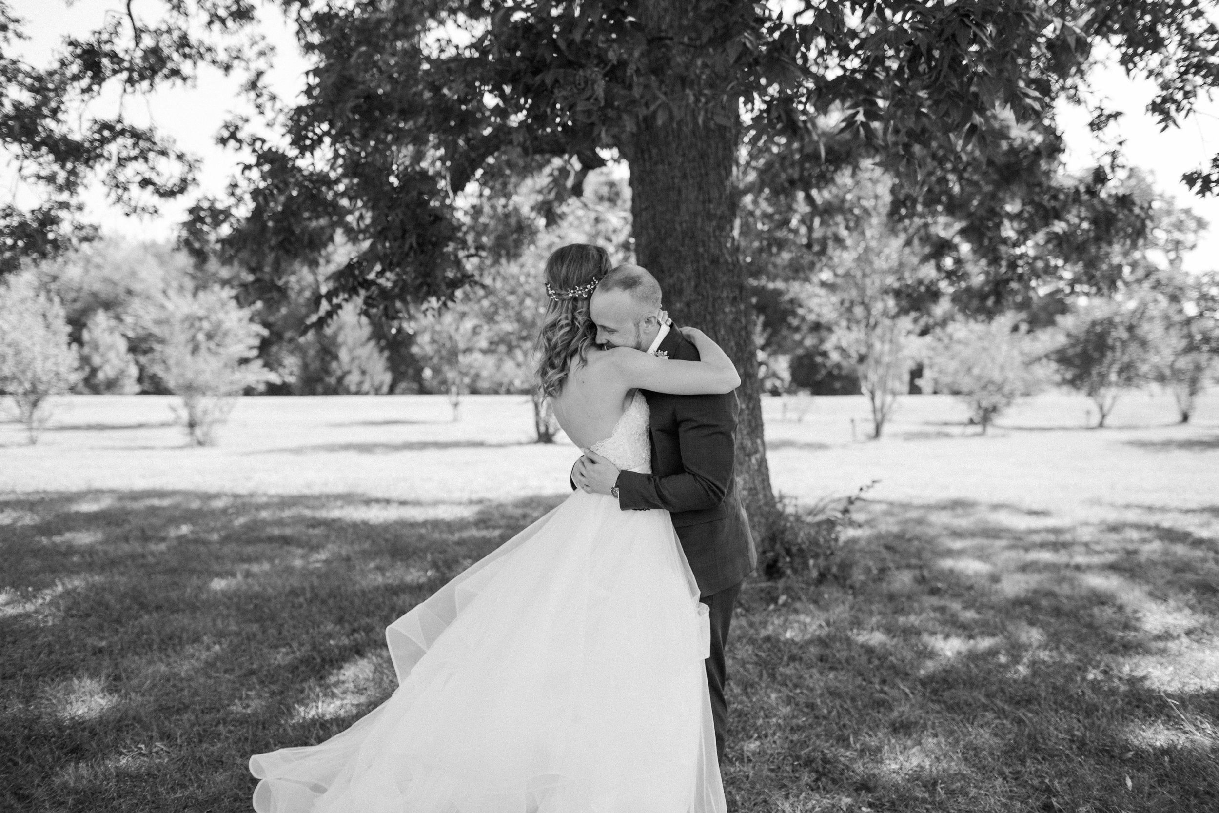 A first look with the bride and groom at Chandler's gardens