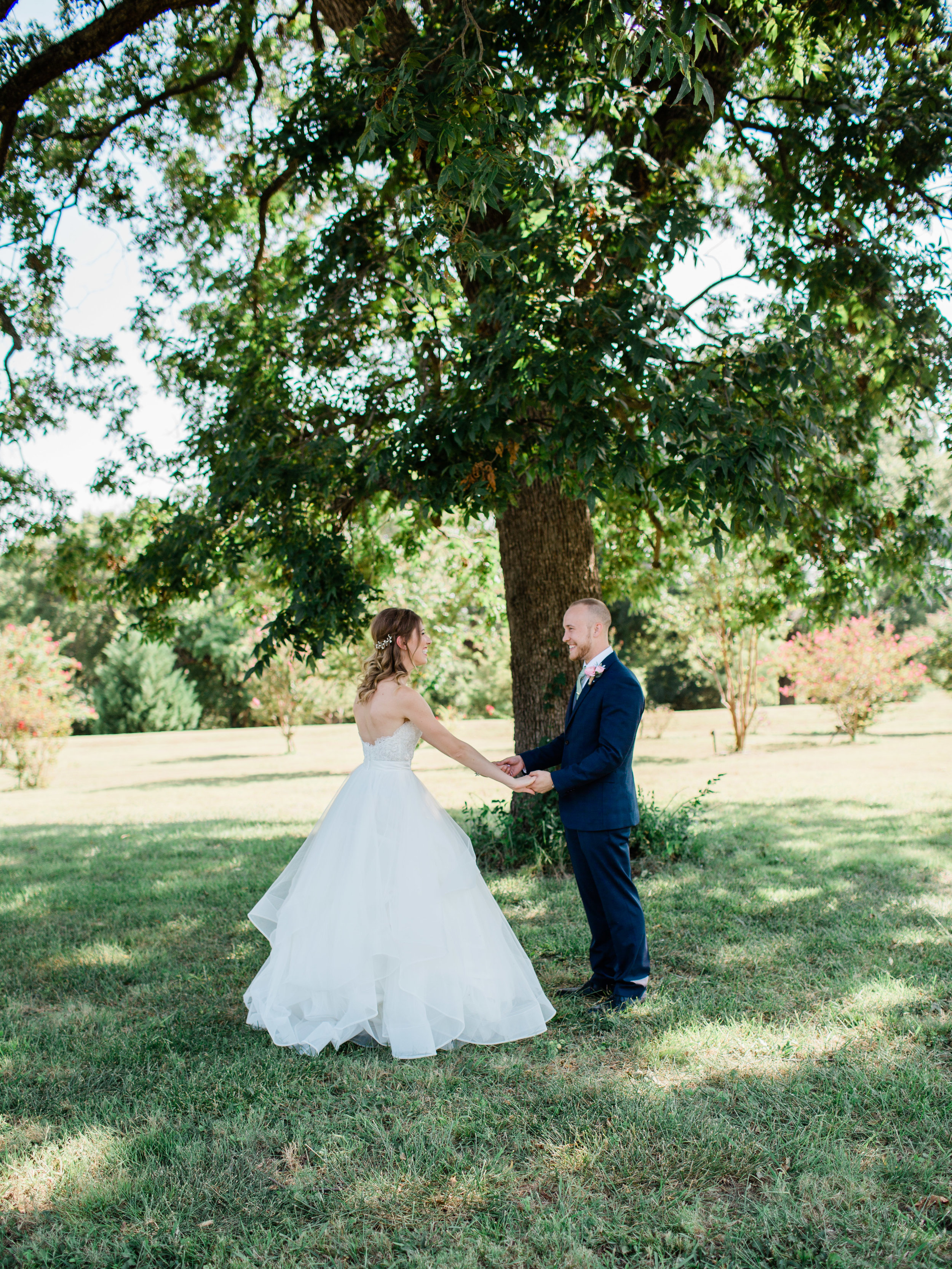 Adelia and Collin's first look at chandlers gardens wedding venue in dfw