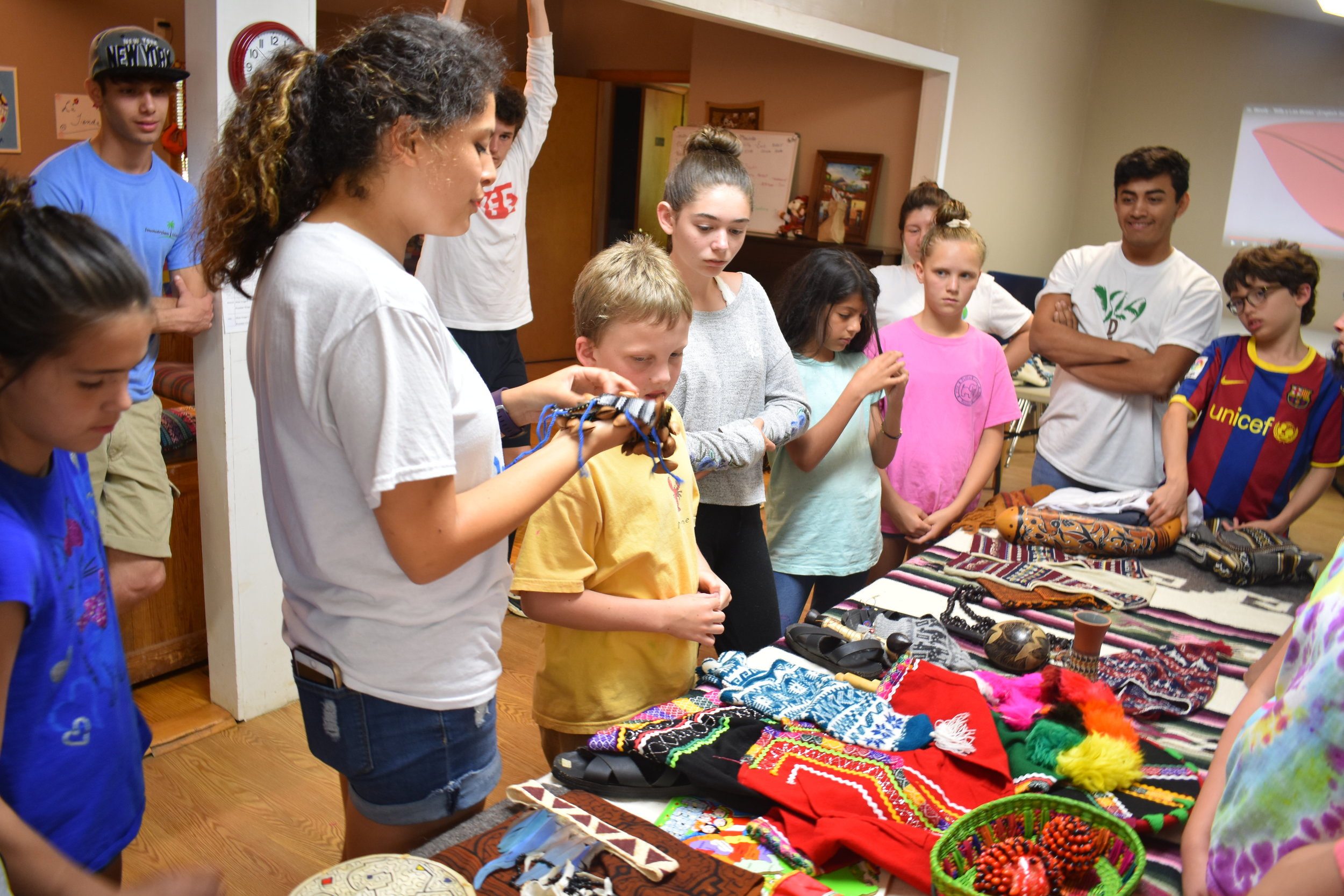 Campers use Camp Peso's to buy culturally relevant gifts, toys and other items. Camp Pesos are earned for performing certain tasks and actively engaging in conversation.
