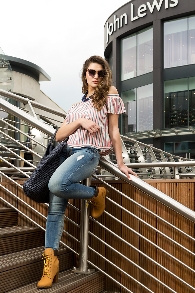 Model posed on steps in as part of an outdoor fashion shoot. Photo: Keith Mindham