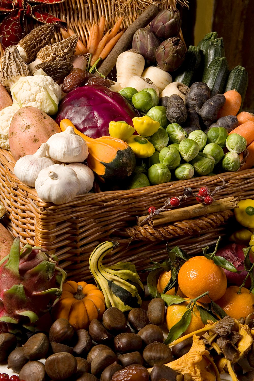 Fruit vegetables and nuts displayed in a wicket basket for magazine food feature.