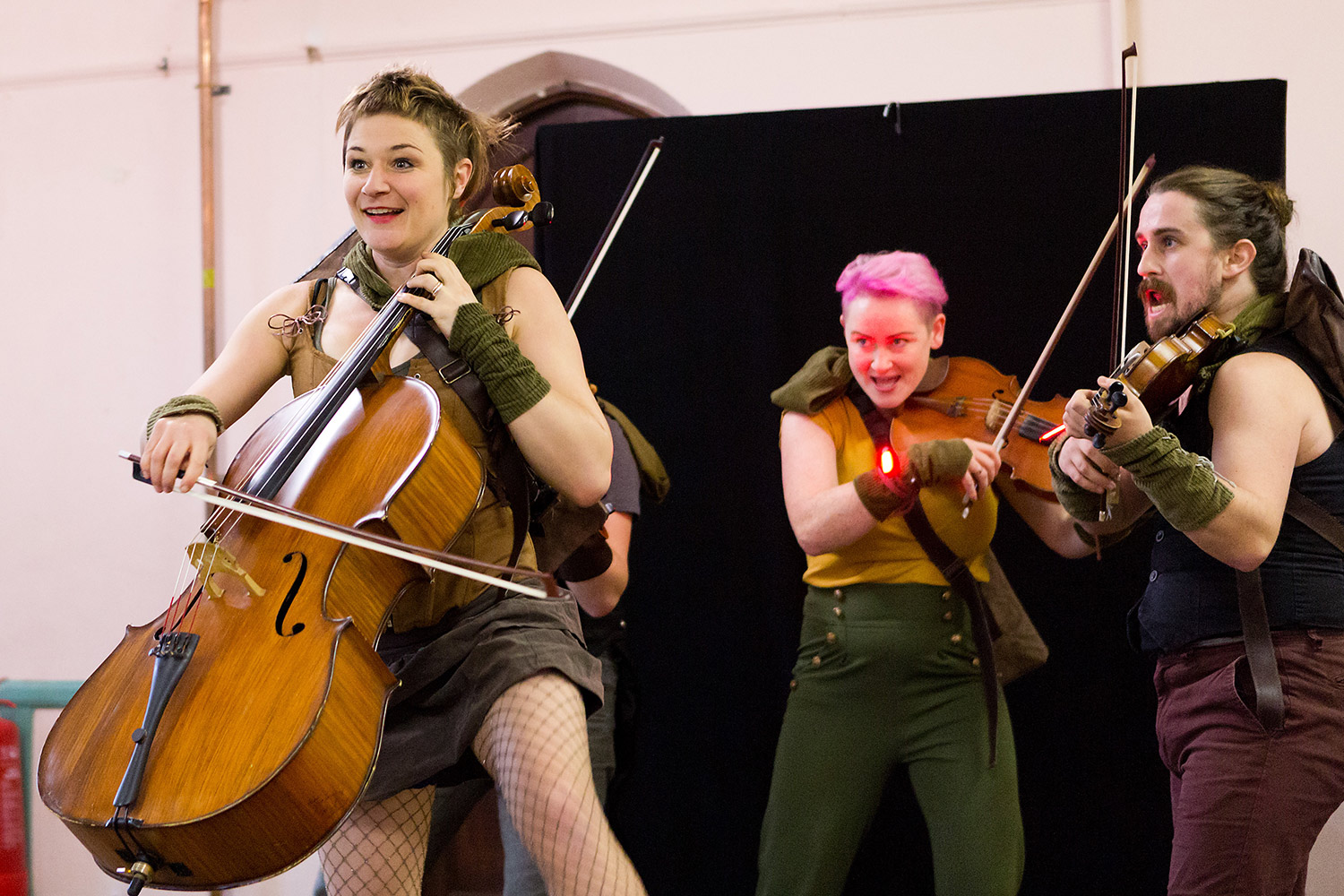 Press photography of string quartet Bowjangles playing an energetic performance in Norfolk