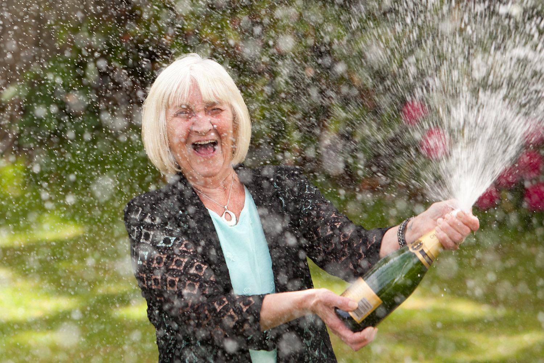 Norfolk Lottery winner spraying champagne. Photographer: Keith MIndam
