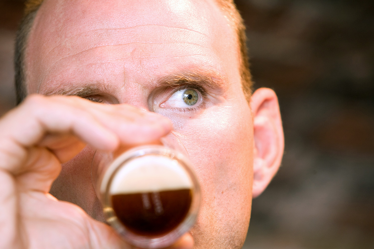 Lawrence Dallaglio samples beer at Greene King Brewery, Bury St Edmunds.