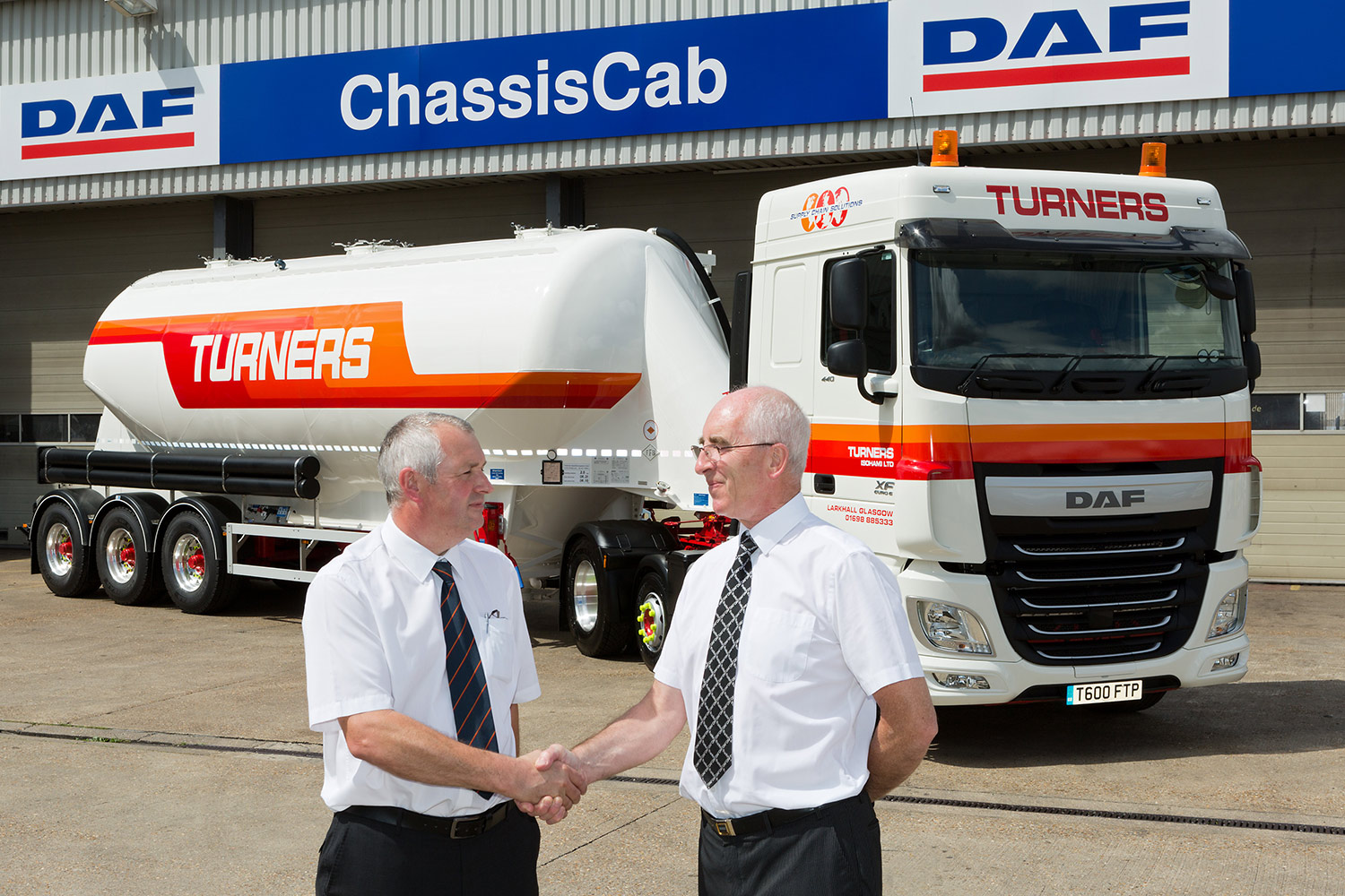 Public relations photography of transport company receive delivery of new truck from Chassis Cab, Cambridge.