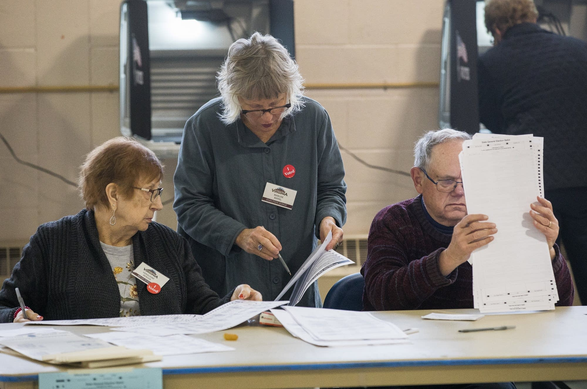 From left: Election judges Geraldine Berger, Marlise Riffel and Wayne Christiansen discuss election-related information Tuesday, November 6, 2018 at the Miners Memorial Building in Virginia, Minn.   Photo: Derek Montgomery for MPR News