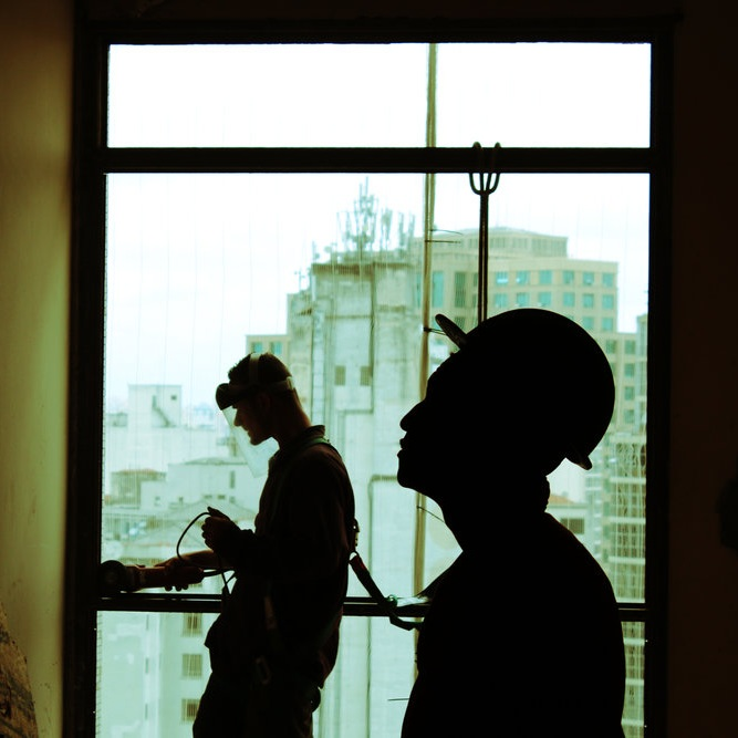 construction workers by a window