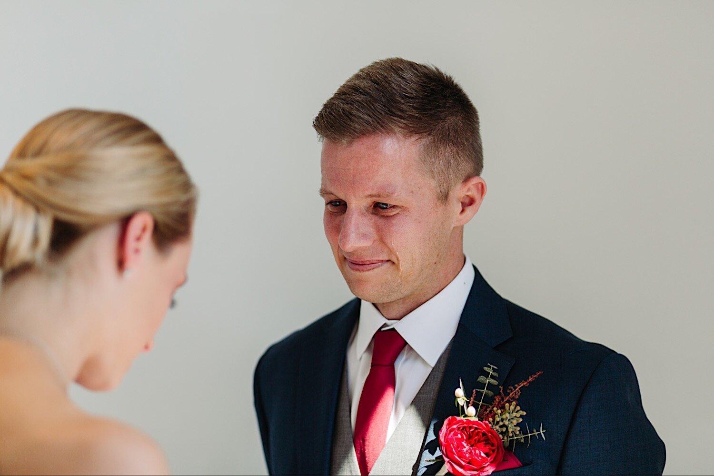 Bride and groom getting at Loft 310 Kalamazoo