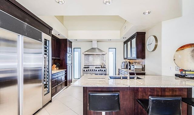 This Monterrey at Mountain View home takes on a clean contemporary look with rich cabinetry. The big feel of the 90's era build gives lots of natural light and volume. 👍 Or 👎 in the comments 👇 #interiordesign #cabinetry #90's #azrealtor