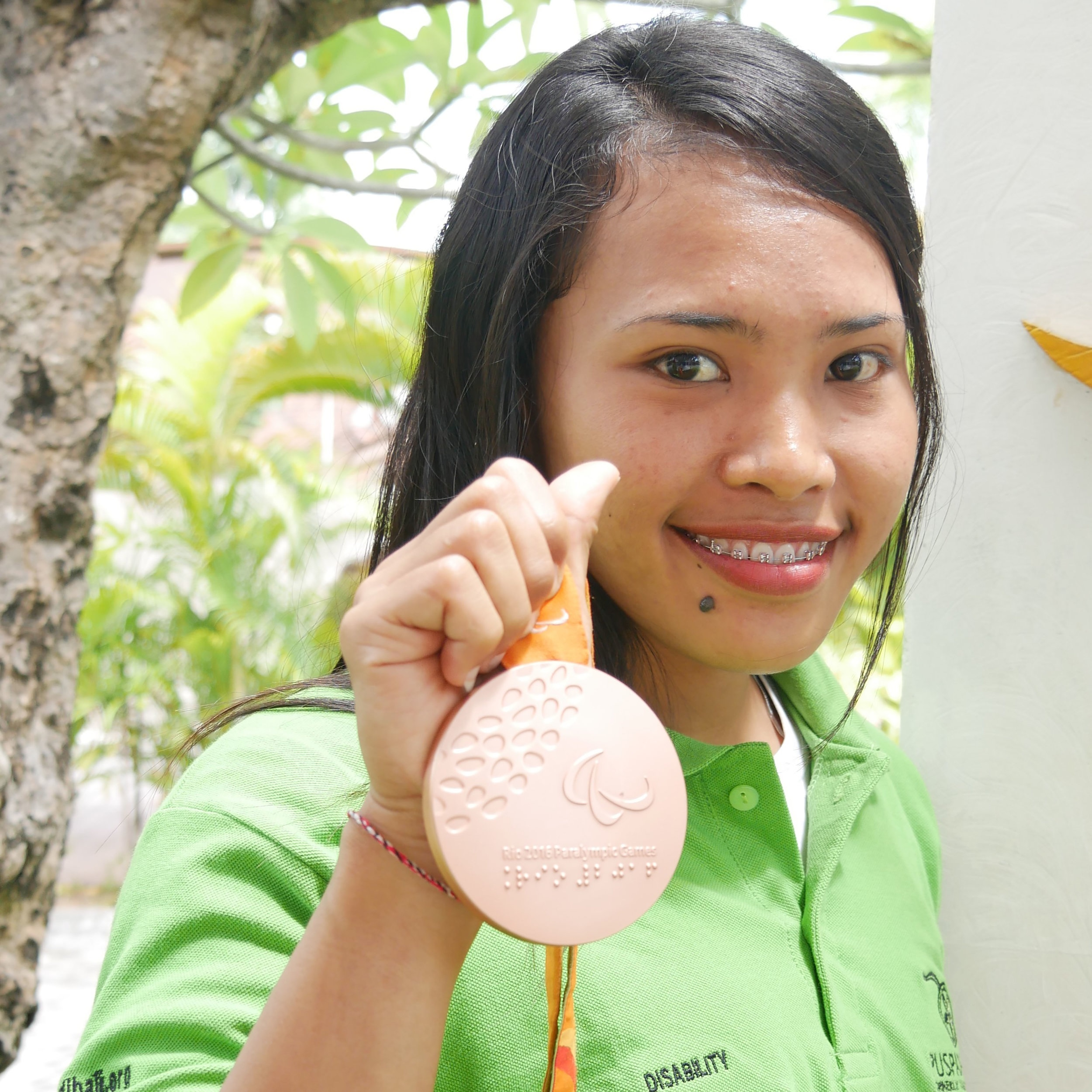 Widiaish+proudly+holding+her+2016+Rio+Paralympics+medal-+%281%29.jpg