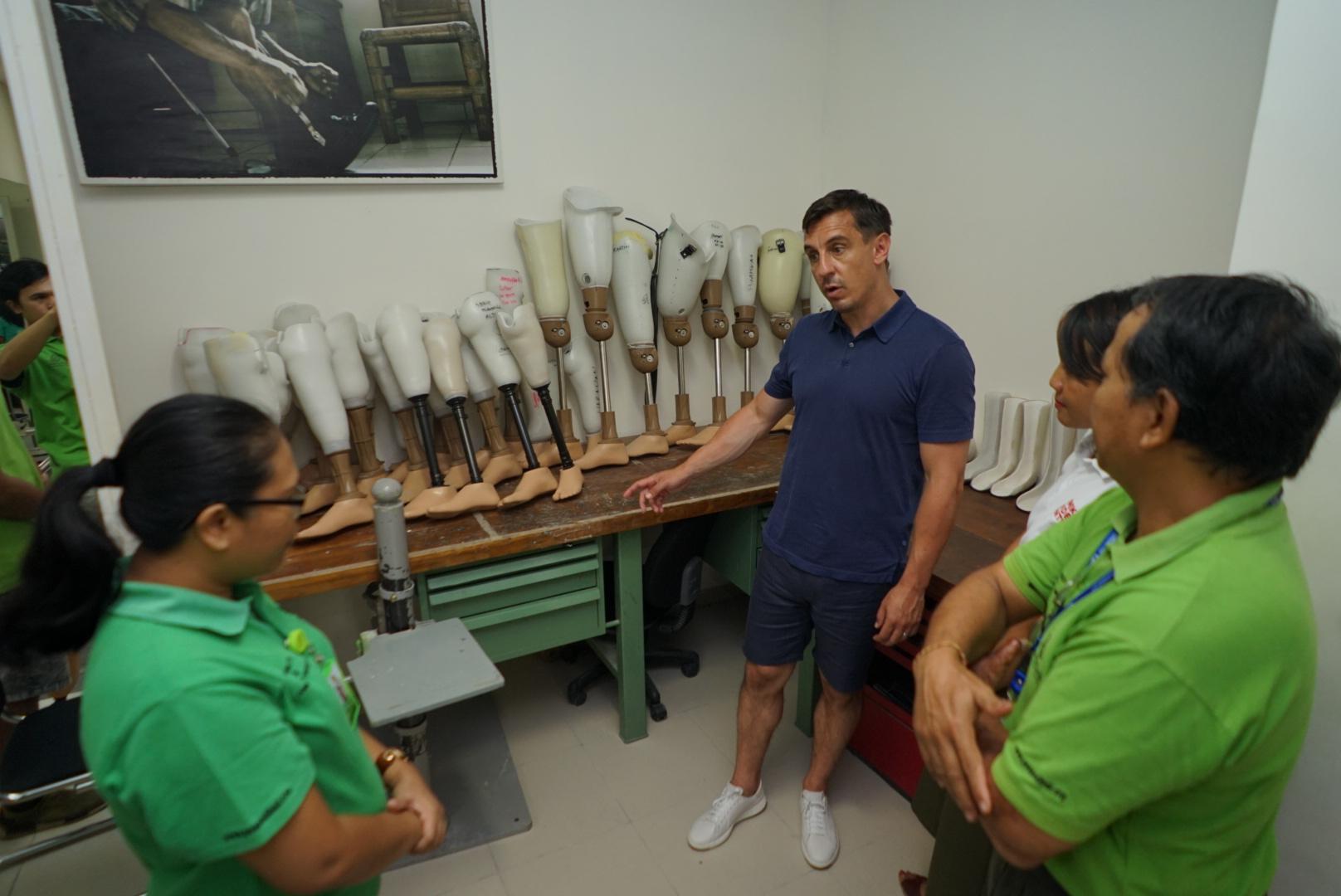 Gary Neville with PUSPADI staff at the PUSPADI prosthetic workshop
